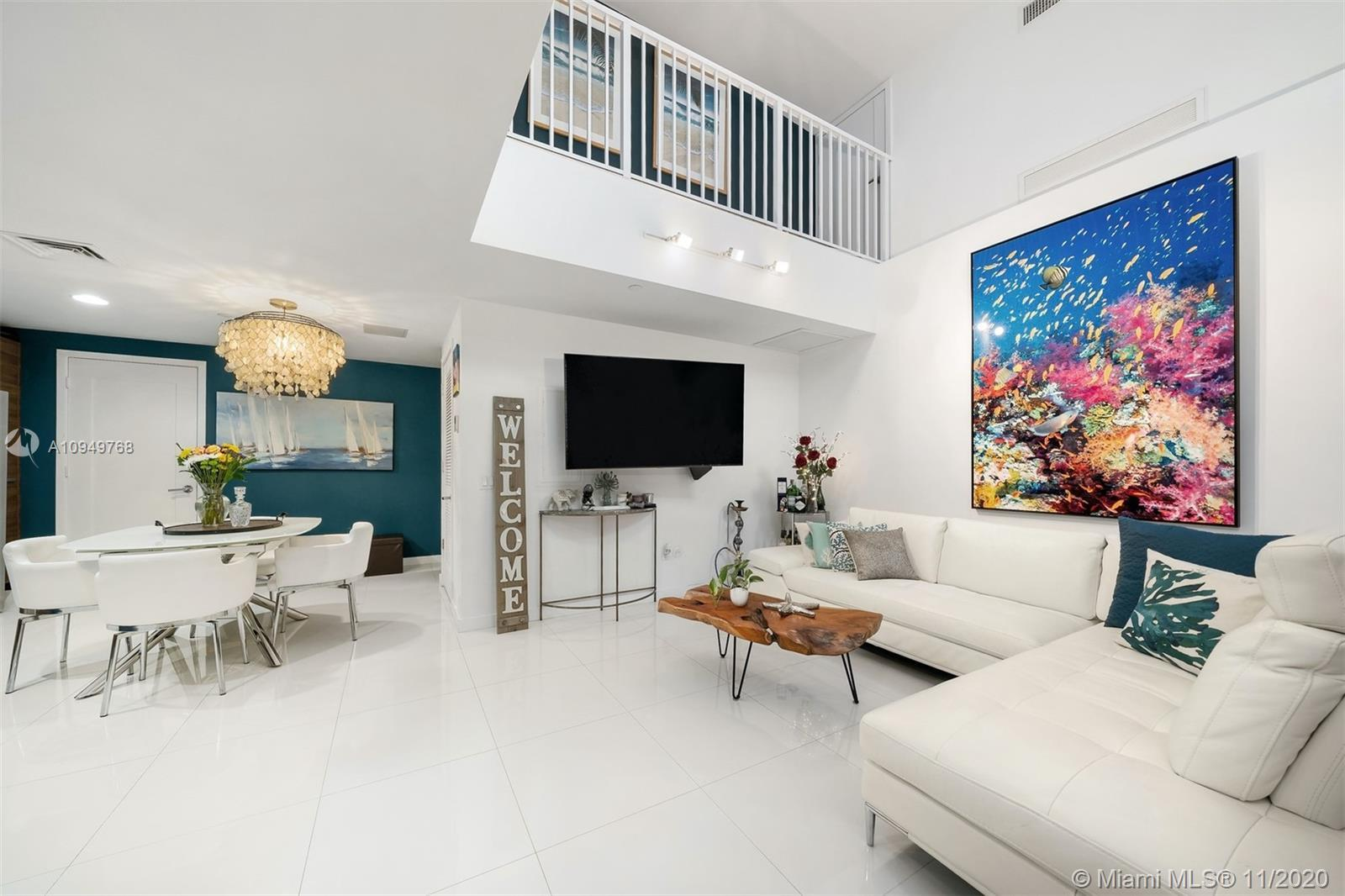 An immaculate 2-story townhouse at The Crimson in Edgewater w/ 1,149 interior square feet, 16.5-foot