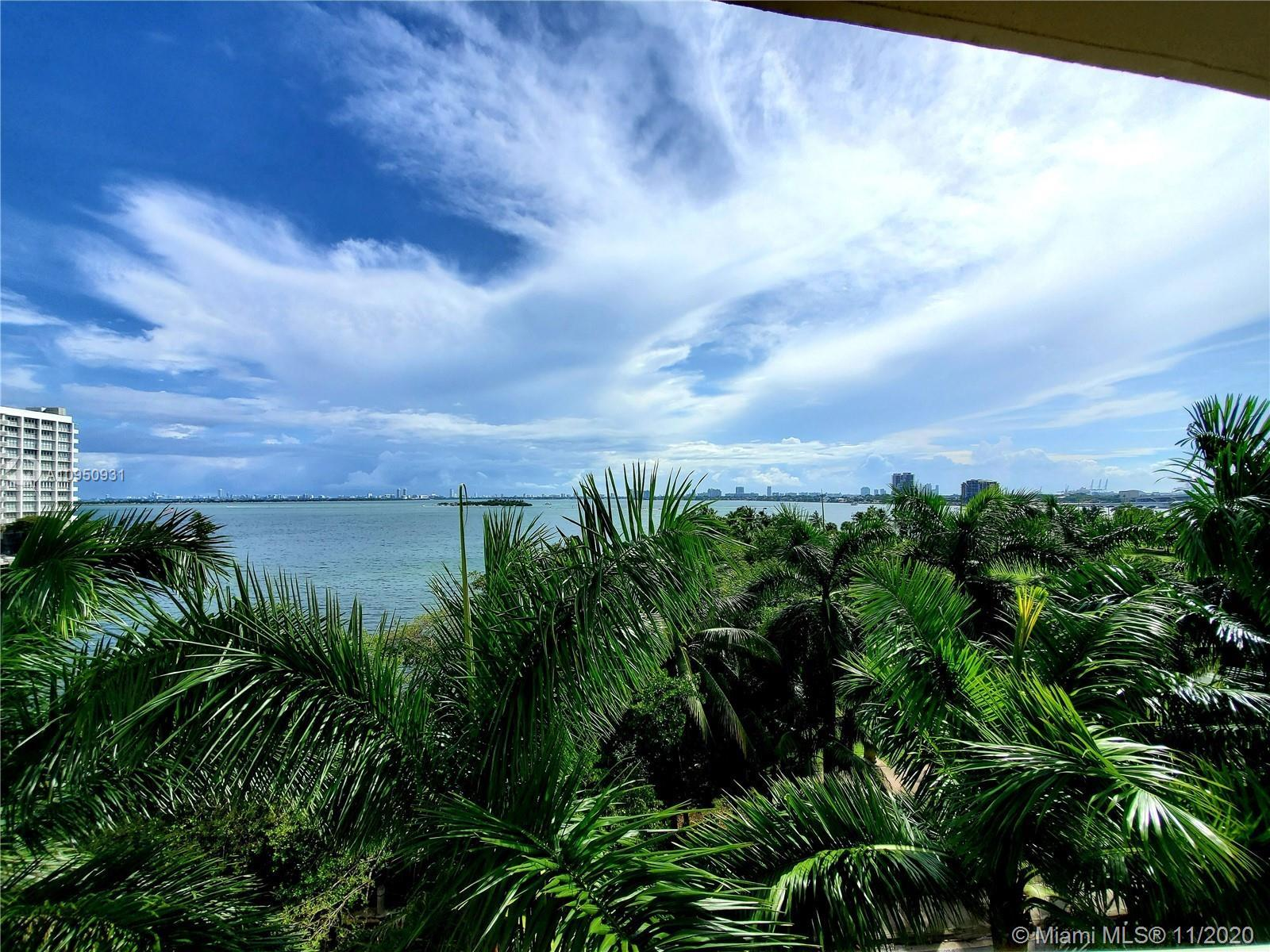Direct East tropical palm tree & bay views from this private 2/2 split floor plan condo. Unit is in