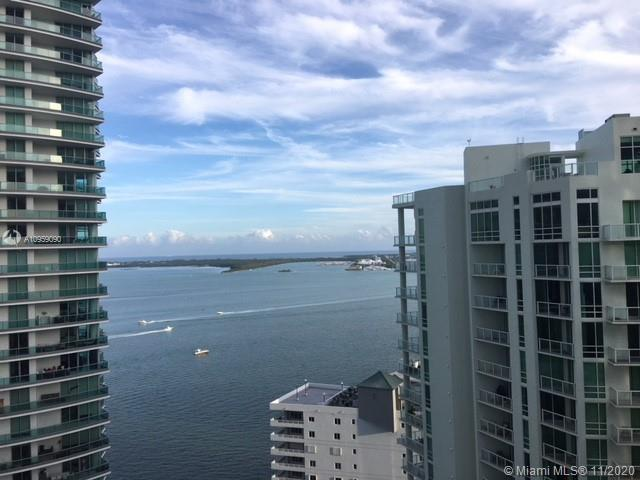 Spectacular unit at the luxurious Brickell House. Upon entry you are greeted by natural sunlight and