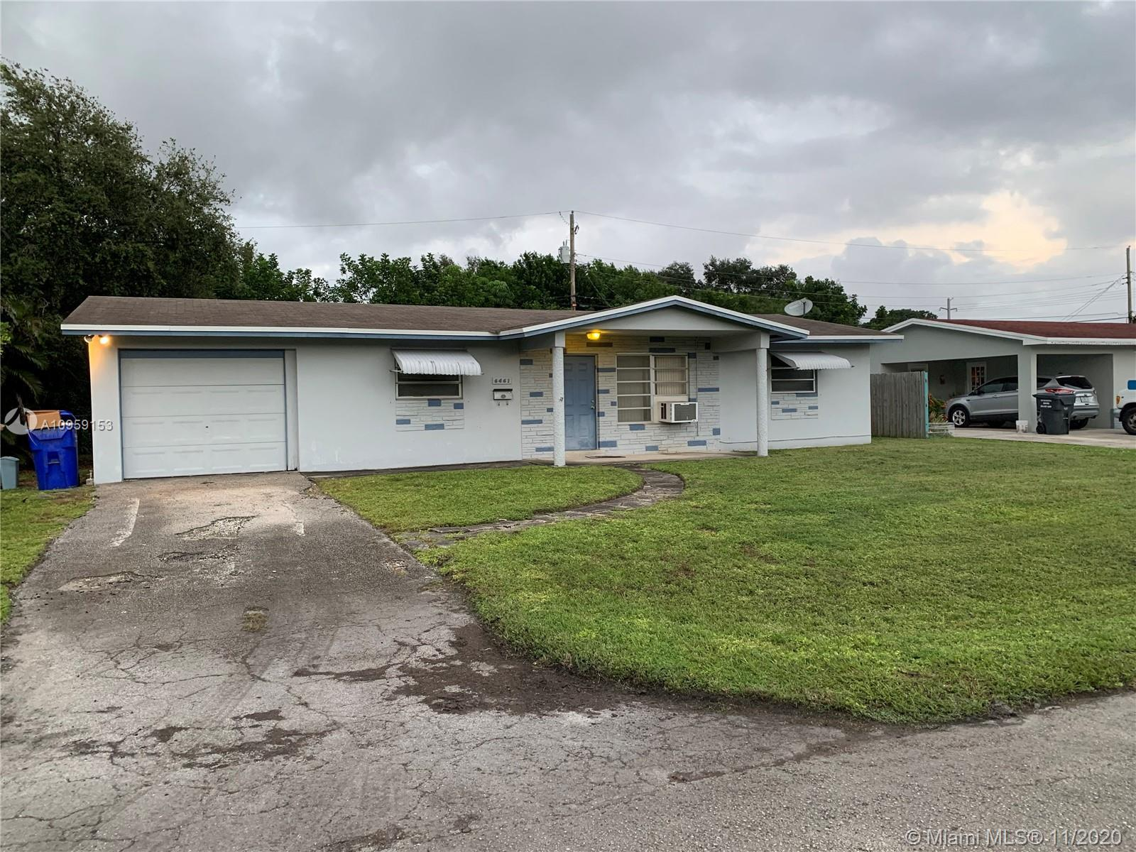 3/2 home on oversized corner fenced lot with a one car garage. Home also has a side gate to put trai
