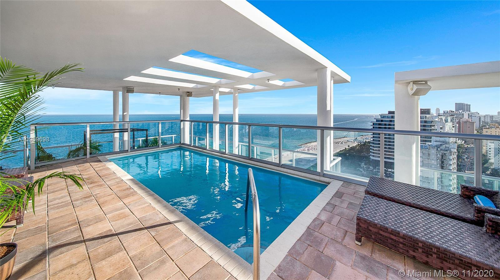 FIRST TIME ON THE MARKET! Experience the ultimate oceanfront SE corner penthouse w/ expansive roofto