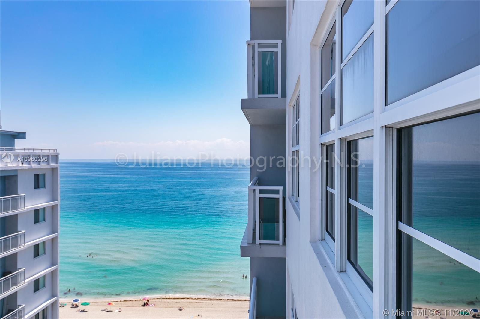 Enjoy beachfront living with this unique one-bedroom unit located in Mid Miami Beach. Travertine til