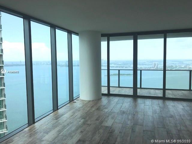 Beautiful Bay views from this spacious and comfortable 1 BED + DEN/2 BATH condo at luxurious Paraiso