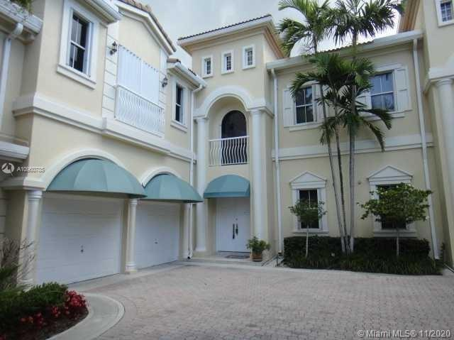Spacious 3/3.5 with Intracoastal views directly on a deep access canal in the gated Courtyards at th