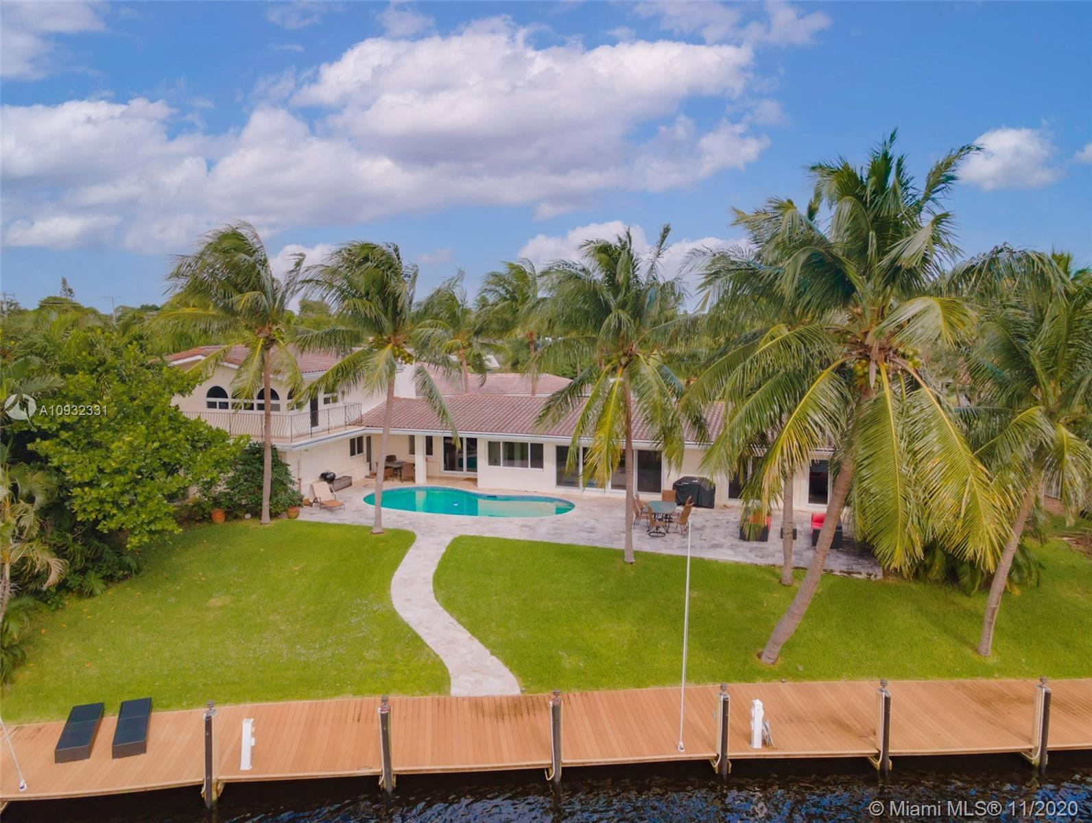 Rare oversized lot minutes from the intracoastal! Perched above the Kingfisher Canal, this extraordi