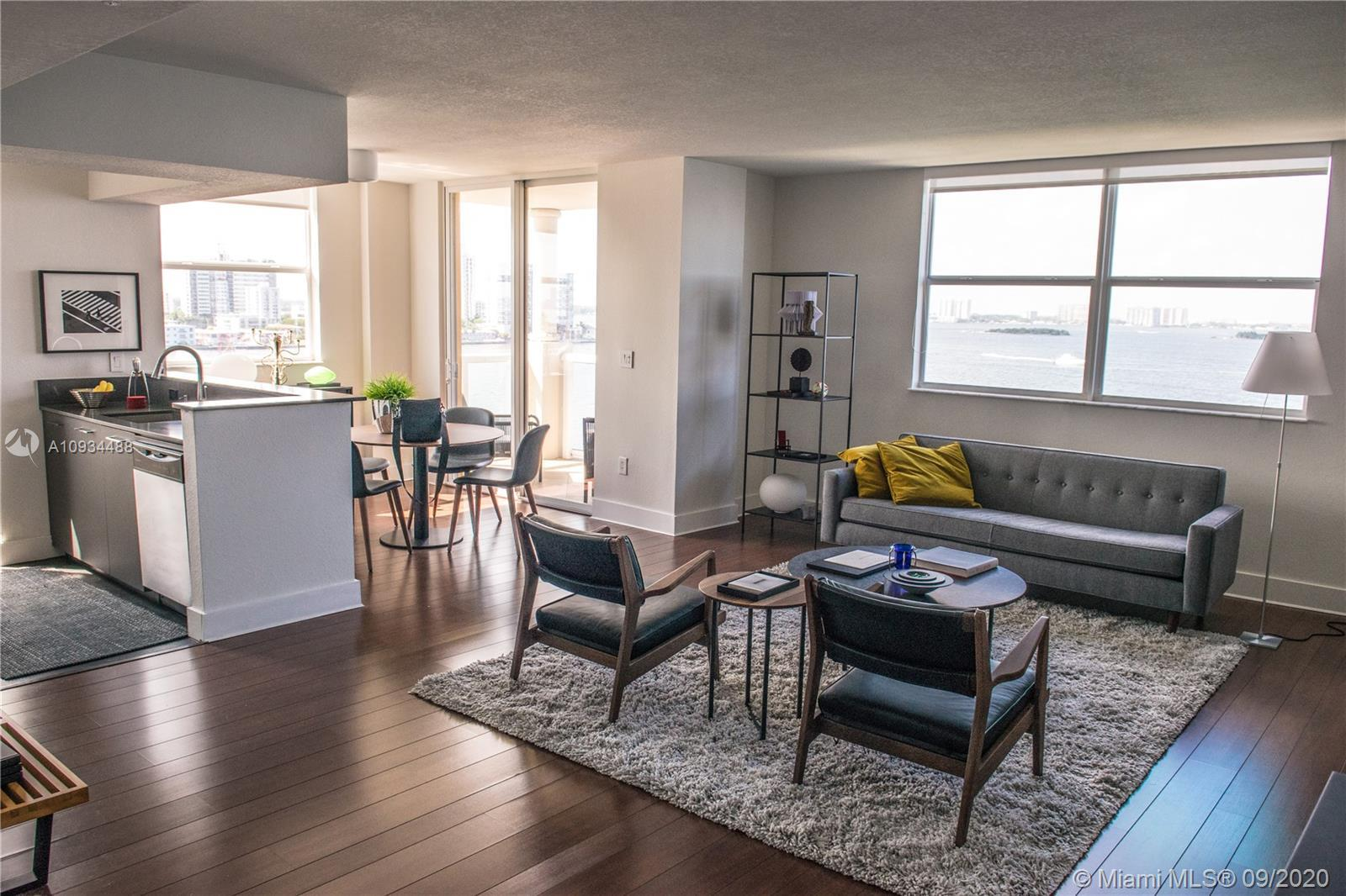 A Luxurious unit in an exclusive boutique, bay-front, building. Gorgeous unobstructed water views of