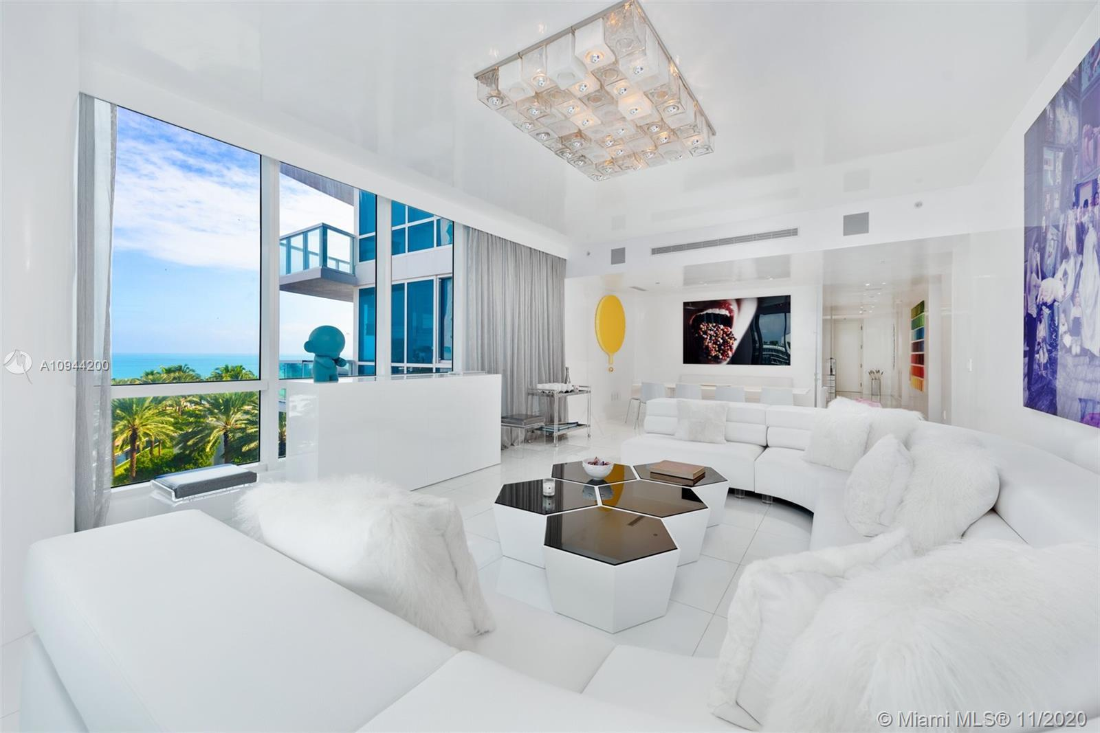 Be wowed the moment you enter this glamorous three-bedroom, white glass home in the sky, in South Be