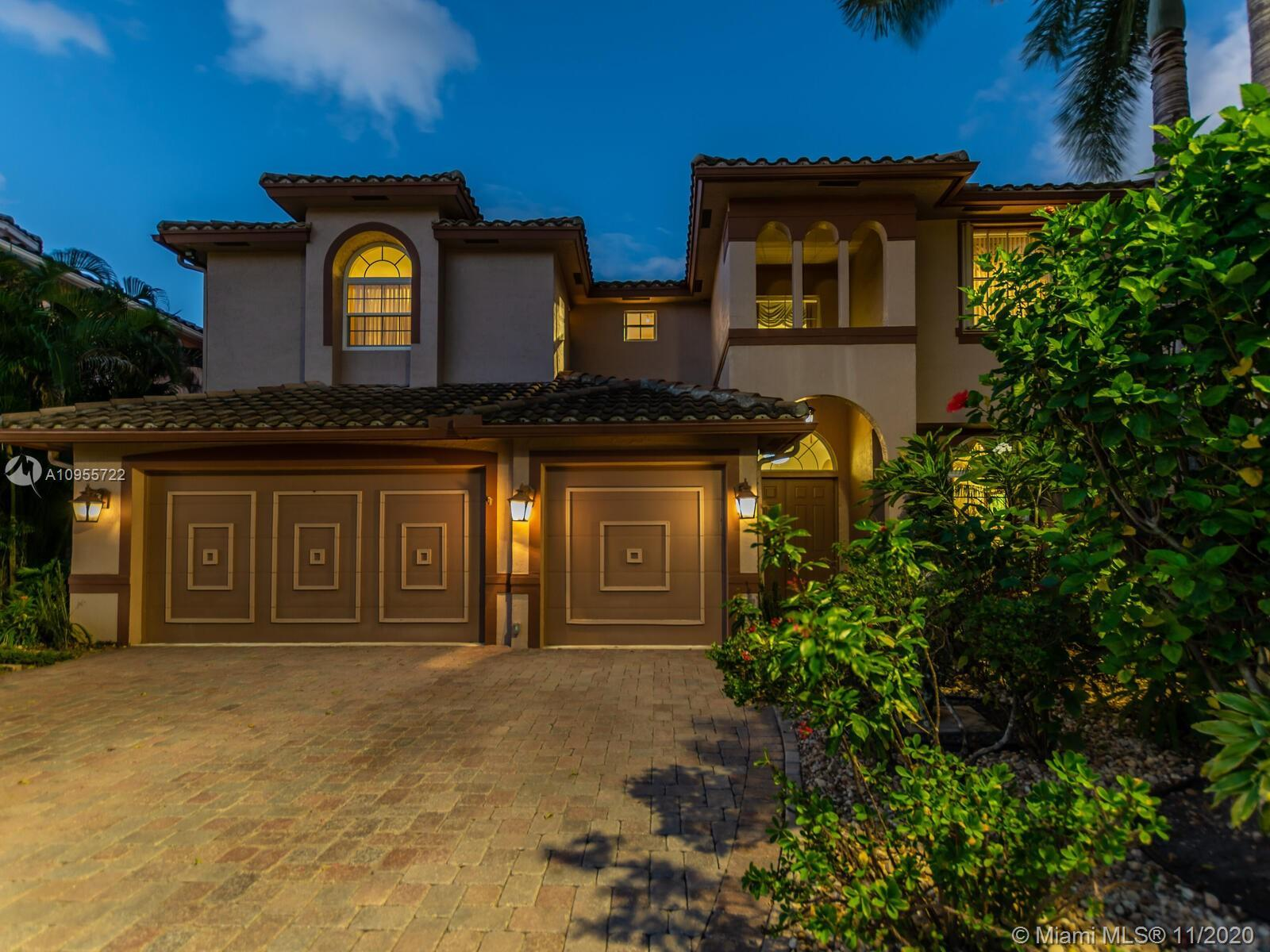 Impressive 5 bed |4 bath pool home, w/an elevator & 12' ceilings, nested on a private lot offers gen