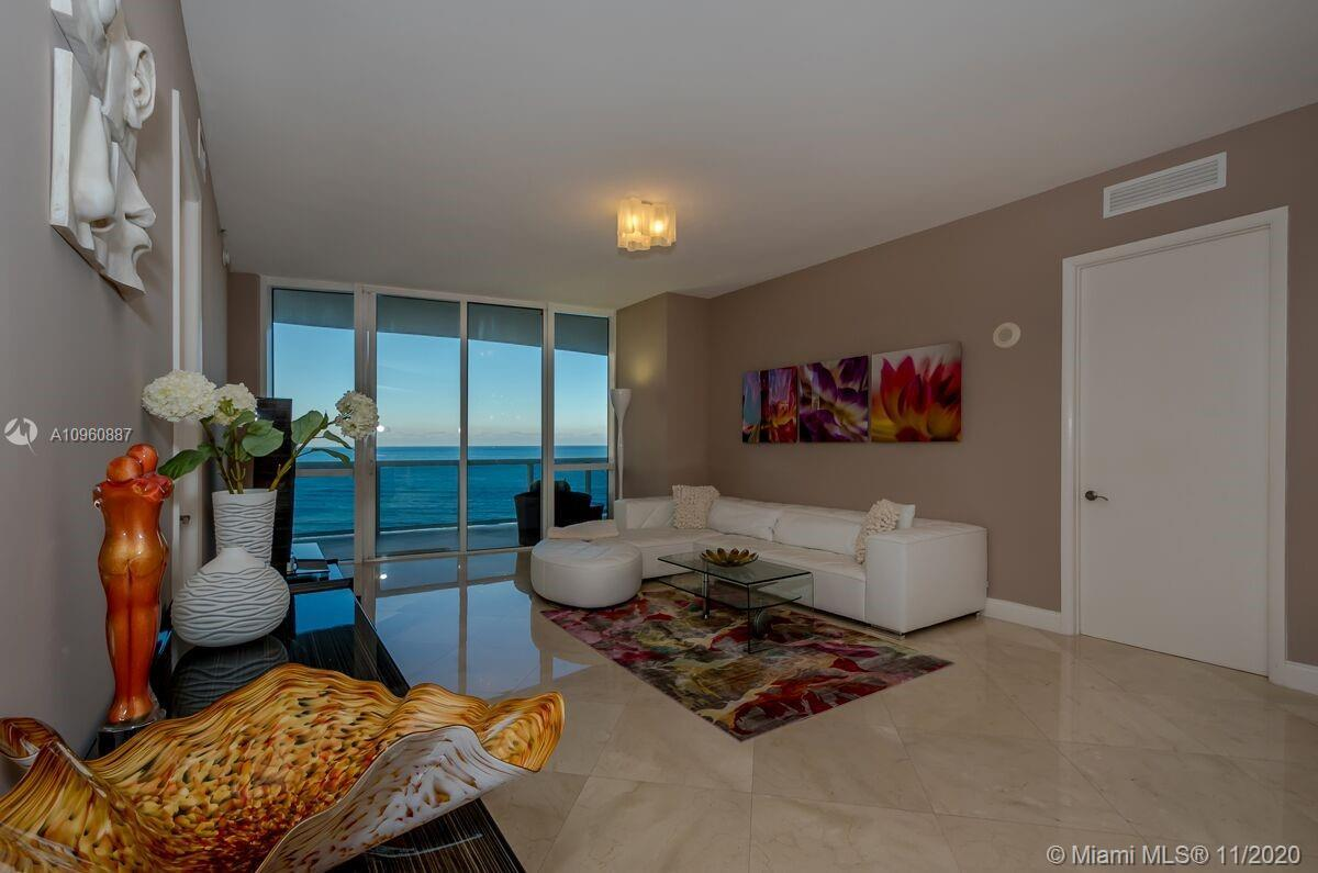 SPACIOUS OCEAN RESIDENCE, PROFESSIONALLY DECORATED WITH 2 BEDROOMS PLUS ENCLOSED DEN. DEN HAS ITS OW