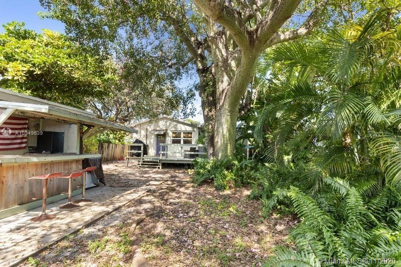 Charming Hollywood home. Remodeled kitchen & bath. Tile and wood flooring. Huge wood deck looks out