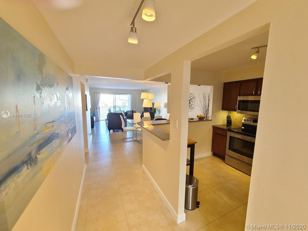 Amazing turn-key 2/2 with water view of the Golden lake isles leading to the intracoastal waterway!