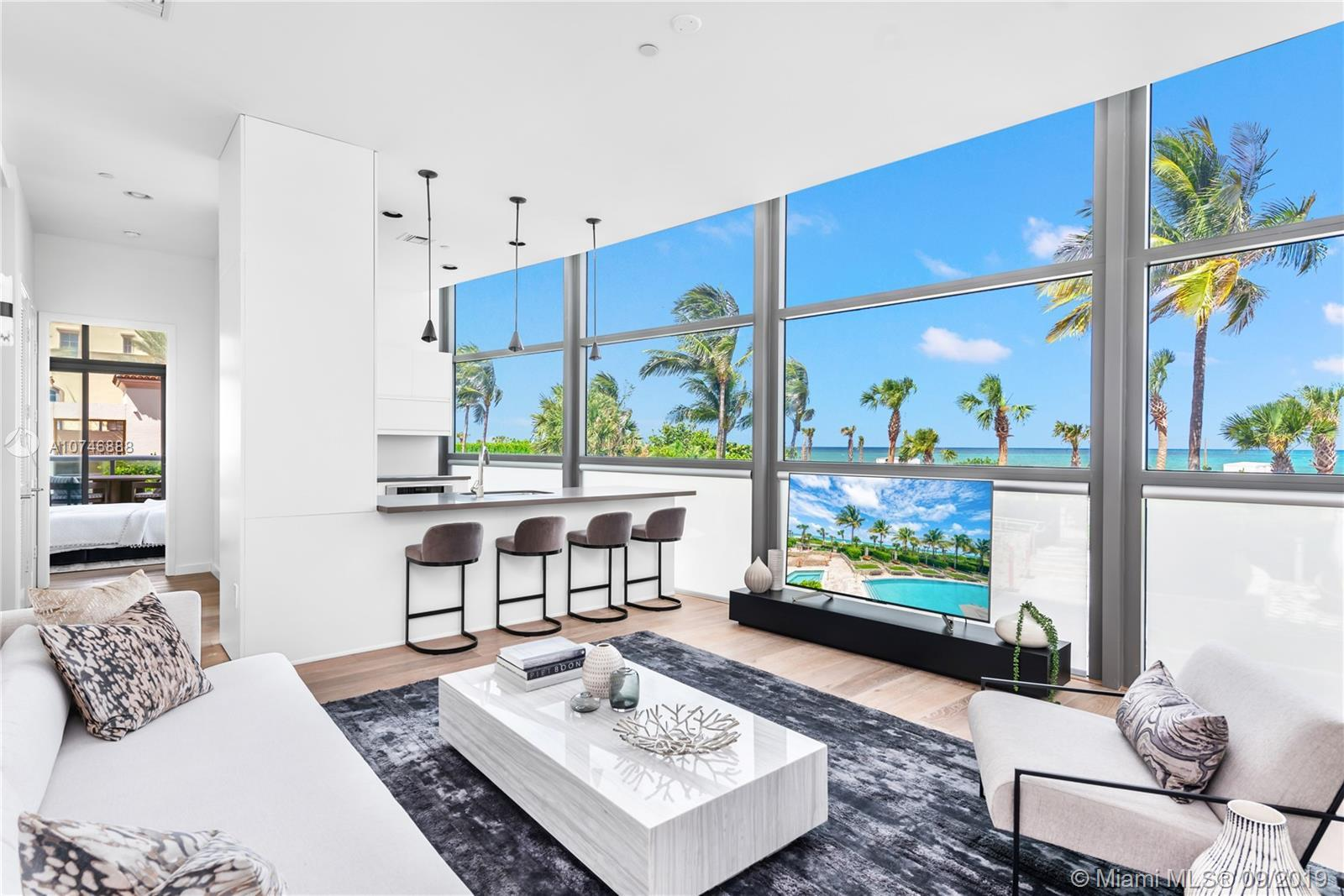 Residence has floor-to-ceiling windows with direct Atlantic Ocean views and super high ceilings. Bra