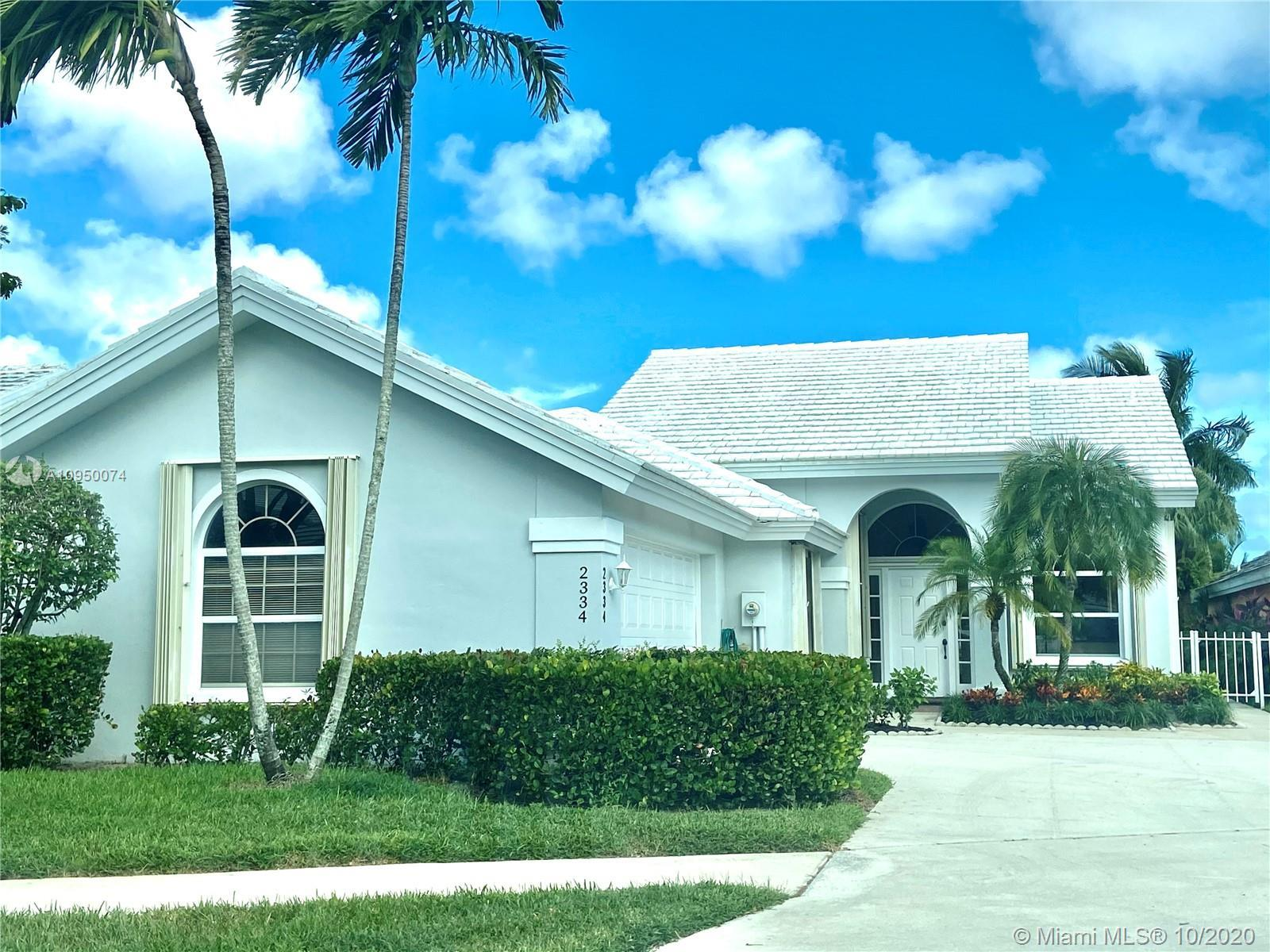 Beautiful waterfront home in private security gated Golf community. Hurricane protected accordian sh