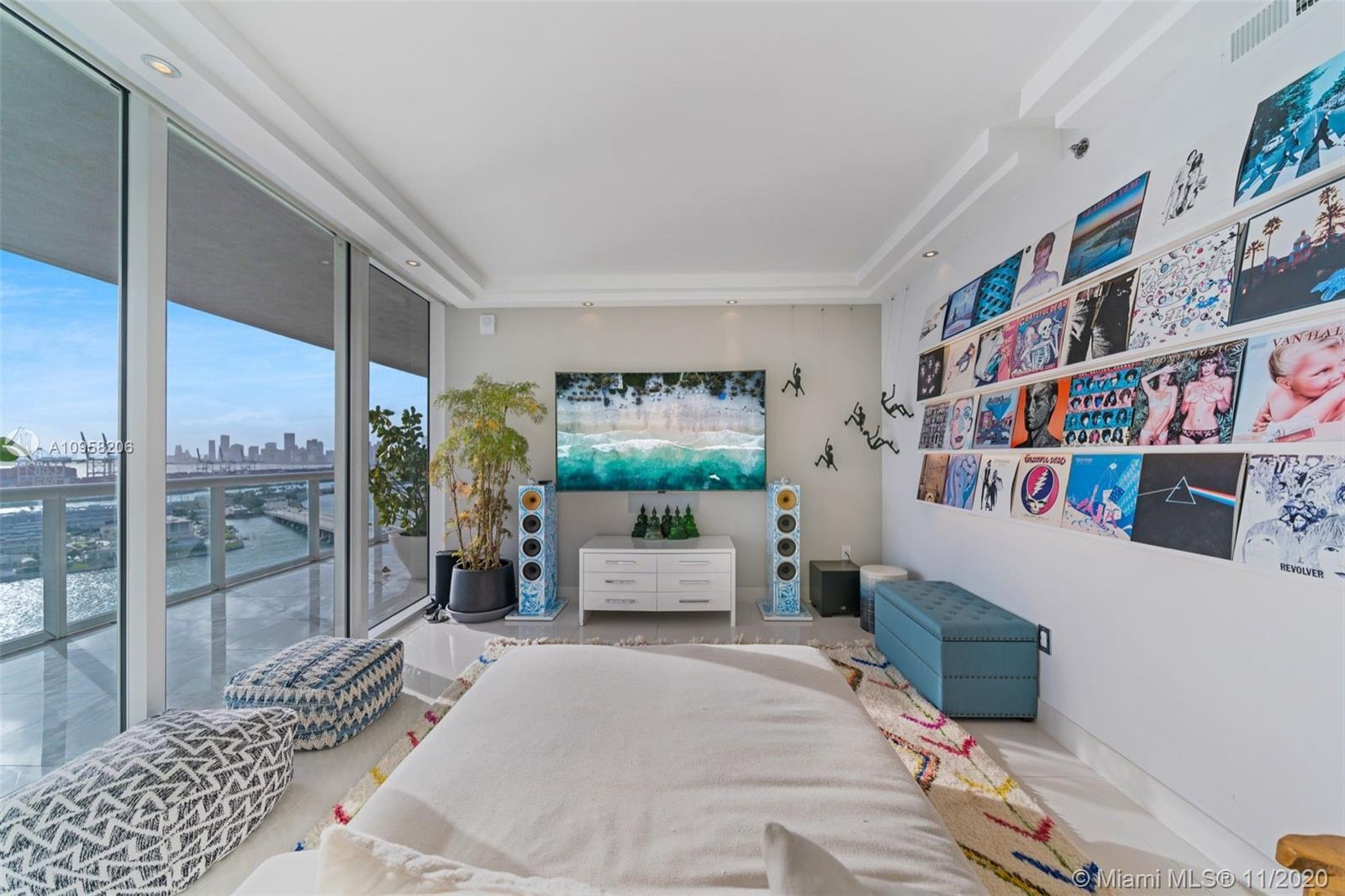 this unit is very special it has been opened up to allow for the expansive views of downtown miami