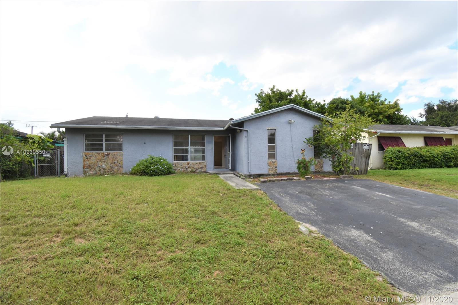 Spacious 3 bedroom pool home offers a bright and open floor plan , large living and dining room, goo