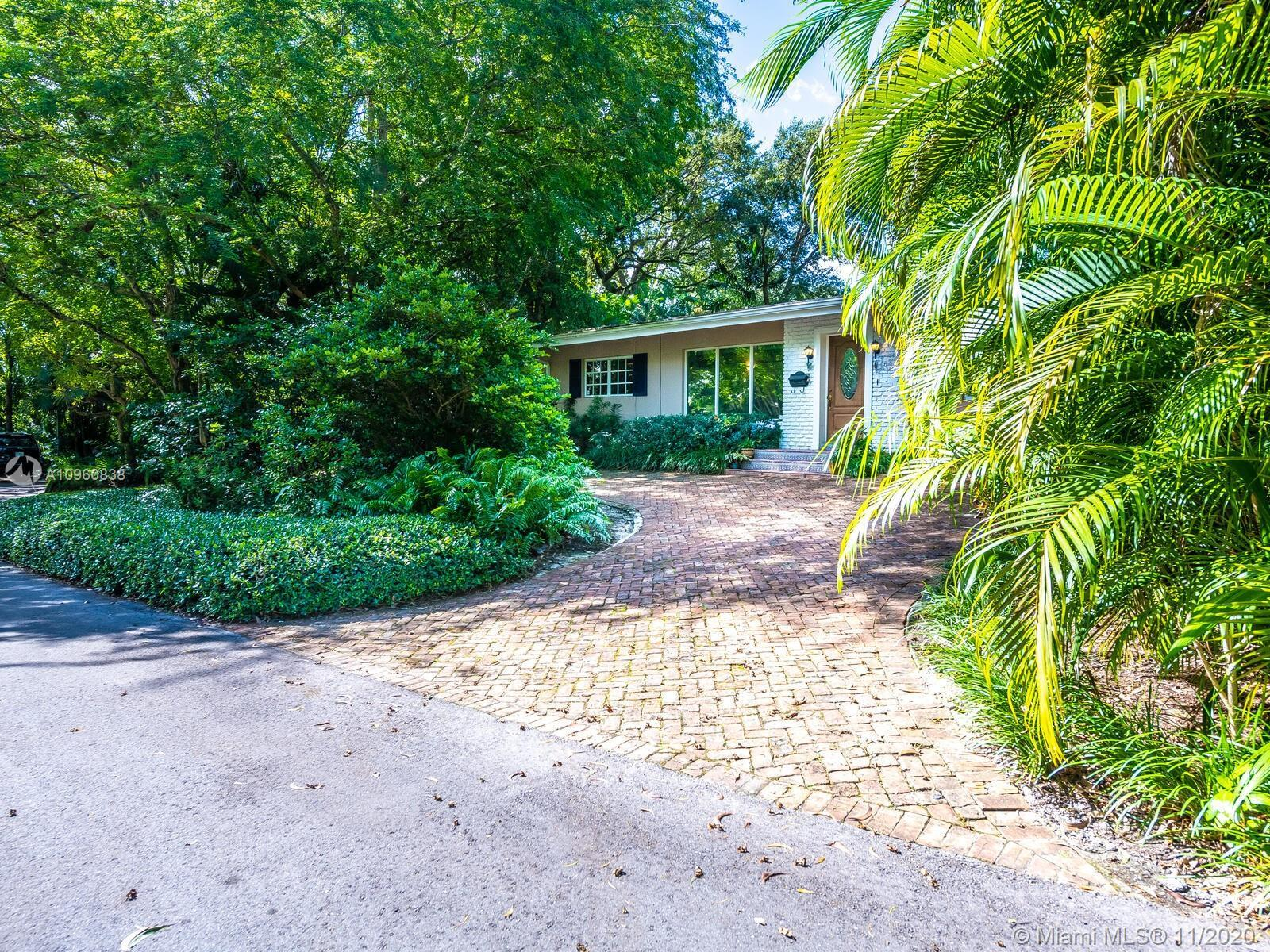 Superbly located in South Coconut Grove on a NON flood zone corner lot, the 3 bedroom / 3 bathroom h