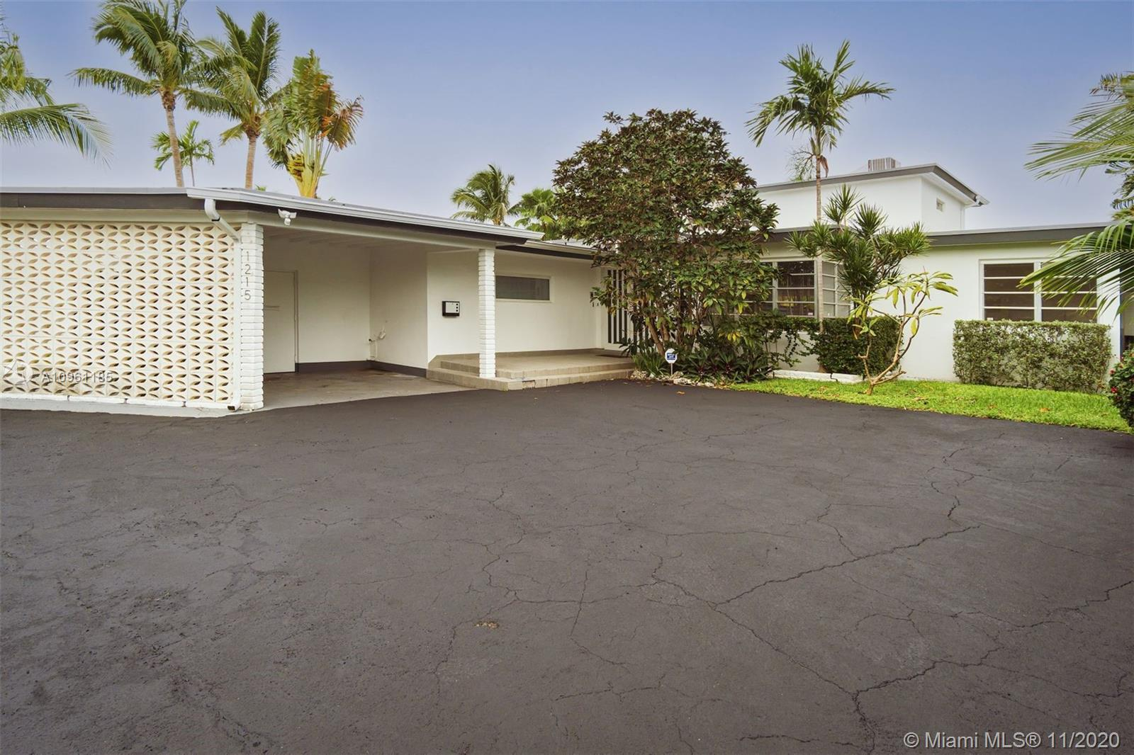 Waterfront home located in Biscayne Point, a gated community, close to the beach, schools, shops, ca