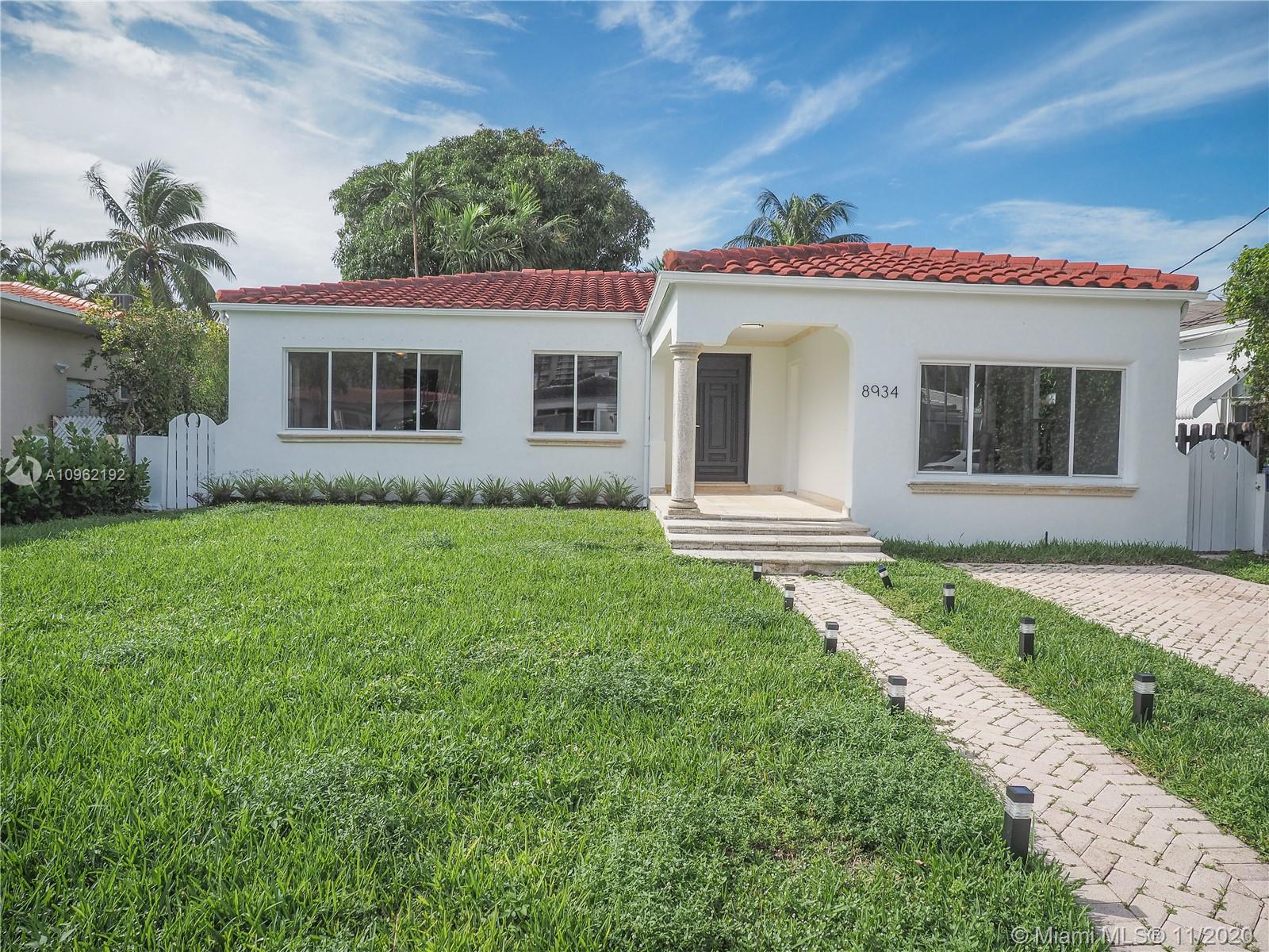 Renovated 5 bedroom 4 bath home on quiet street in Surfside. This home features an open kitchen with
