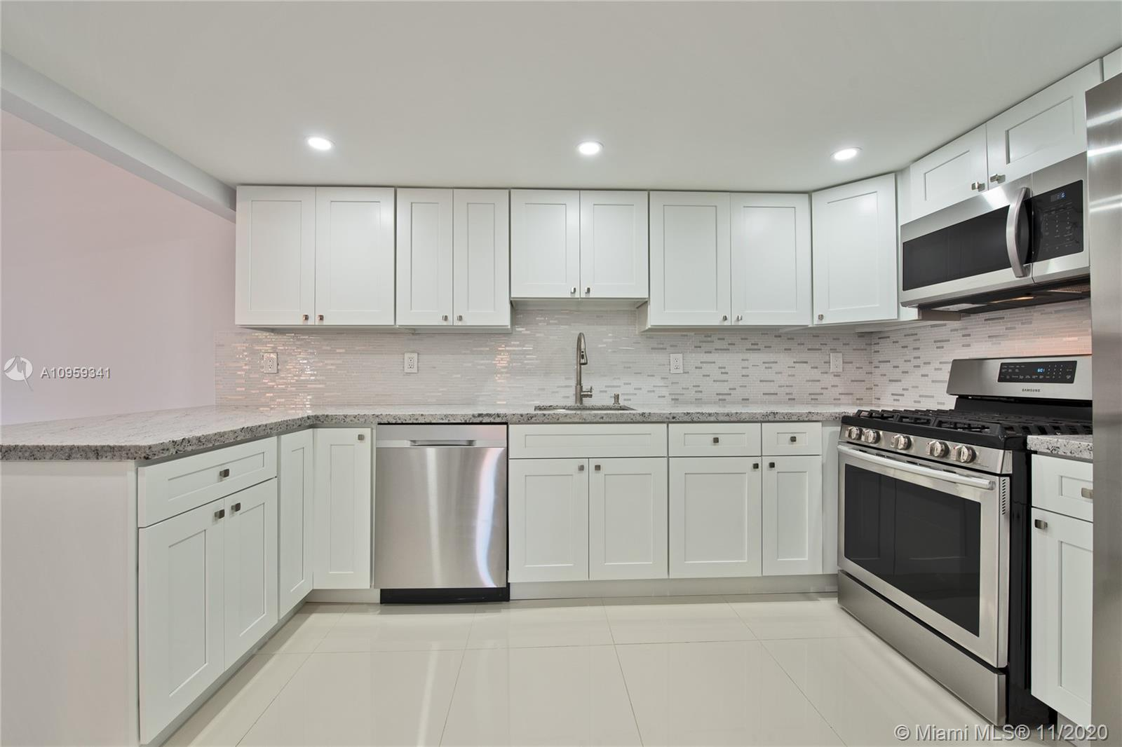 Beautifully remodeled townhome in Snapper Village! features 3/2 tile flooring, remodeled kitchen and baths, all bedrooms upstairs, 2 patios one accessed through living room the other through dining room, gas stove and water heater, washer/dryer in the unit, community has pool, tennis, child play area, guard gate and so much more!Maintenance fee includes: Water, cable, internet, insurance, guard/gate, common area maintenance, pool, club house, window and door repairs, fence.
