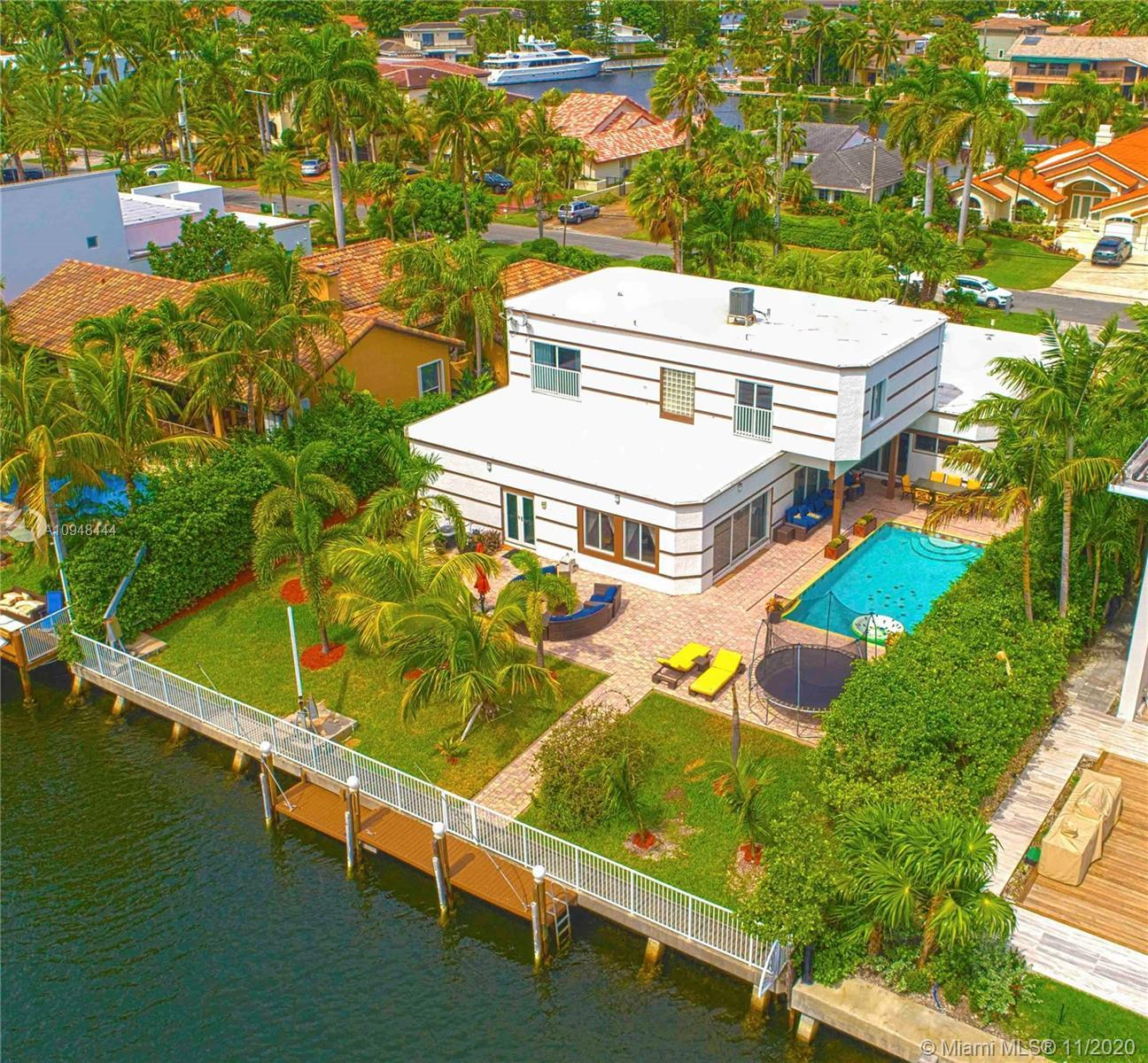 Spectacular waterfront luxury lifestyle home on a very private street in exclusive gated community o