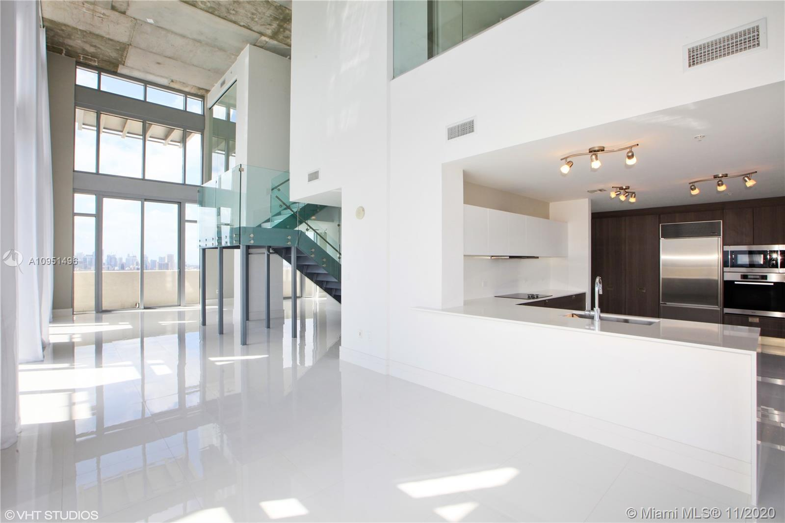 Walking into your Penthouse residence, you are greeted with unobstructed eastern views of Miami Beac
