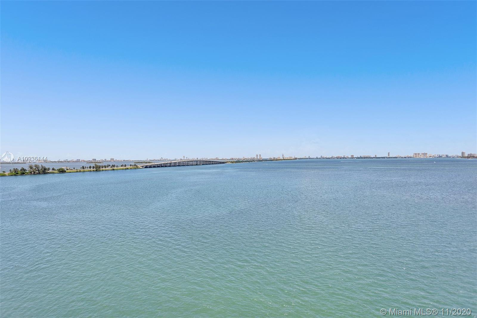 Boutique style building one of a kind private corner unit with breathtaking UNOBSTRUCTED BAY views w