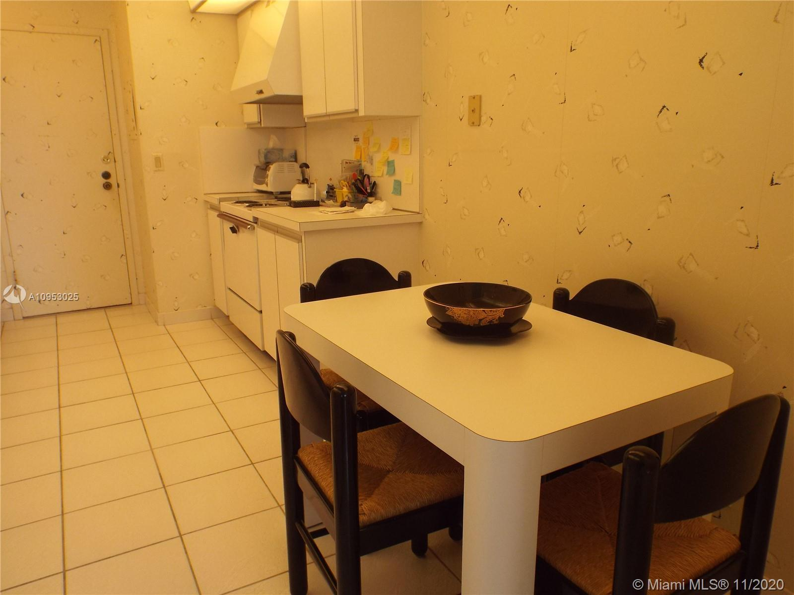 LARGE CORNER UNIT WITH PARK + OCEAN VIEWS FROM LOW FLOOR CONDO. RENOVATED KITCHEN LOTS OF BUILT-INS,