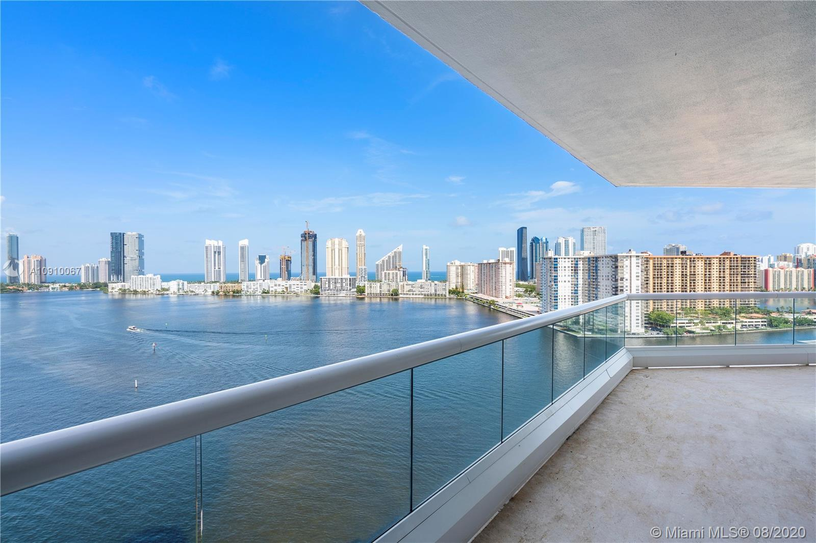 BREATHTAKING WATER VIEWS FROM EVERY ROOM IN THIS 18TH FLOOR SOUTHEAST WRAP AROUND UNIT IN LUXURIOUS