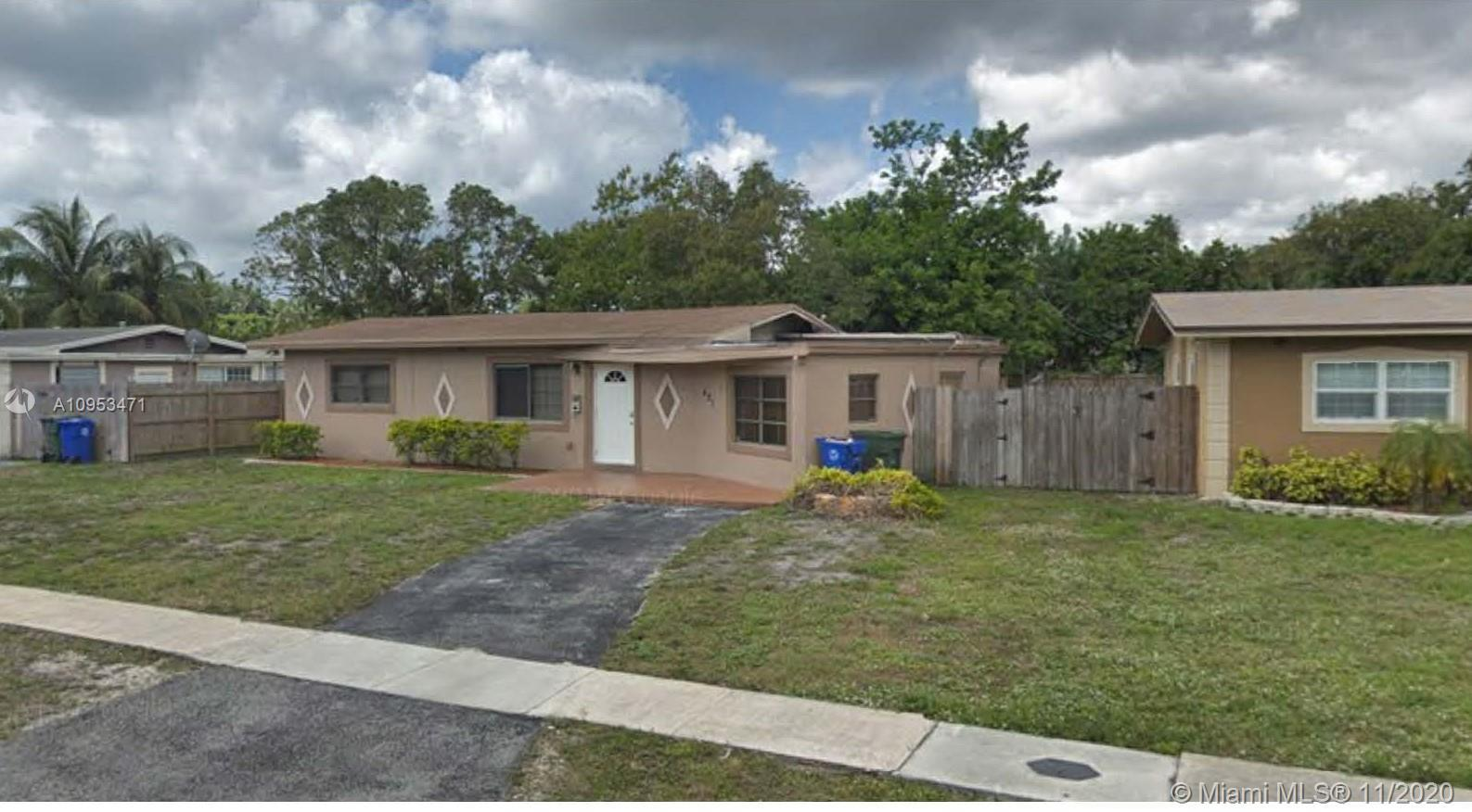 Charming 4 Bedroom 2 Bathroom home with large fenced in yard. The property features exposed wood bea