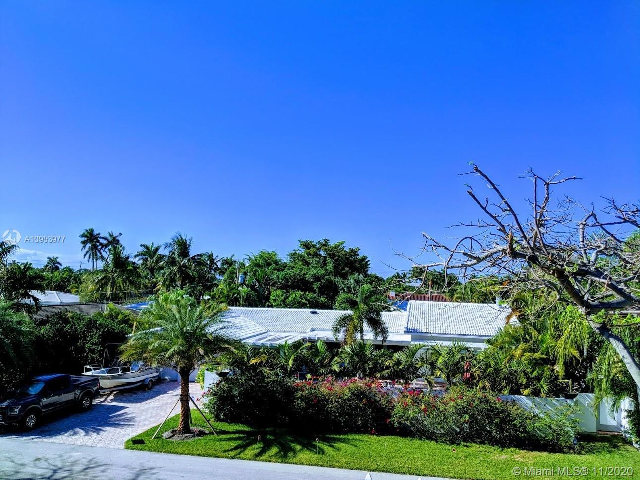 Private and unique walled courtyard pool home in prestigious & much sought after Coral Ridge neighbo