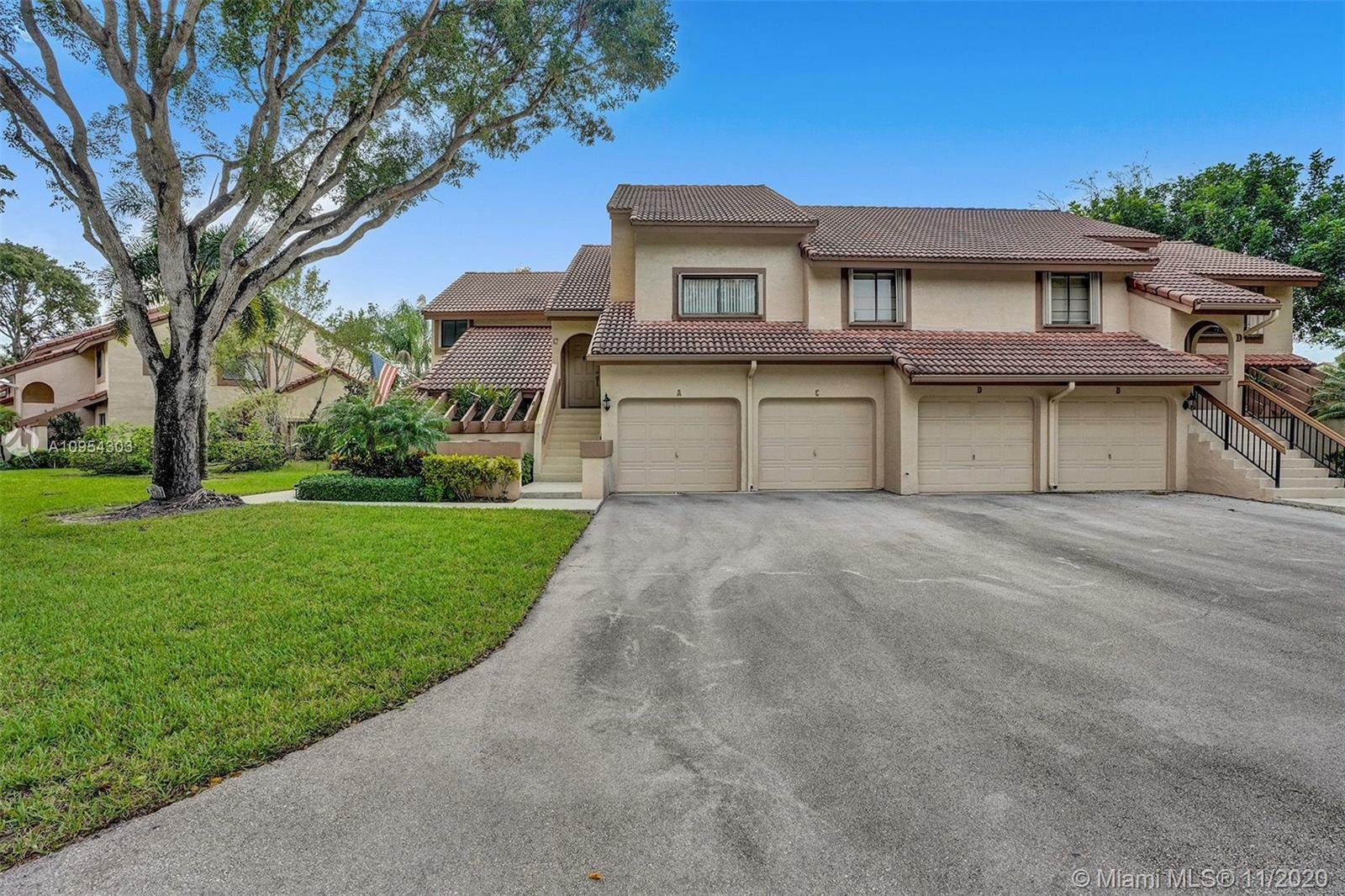 This beautifully turn-key unit features a large covered patio with a water view, 1 car garage, vault