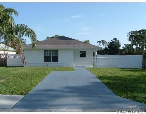 Beautiful single family home on large property in the heart of Jupiter. Newer A/c., updated kitchens