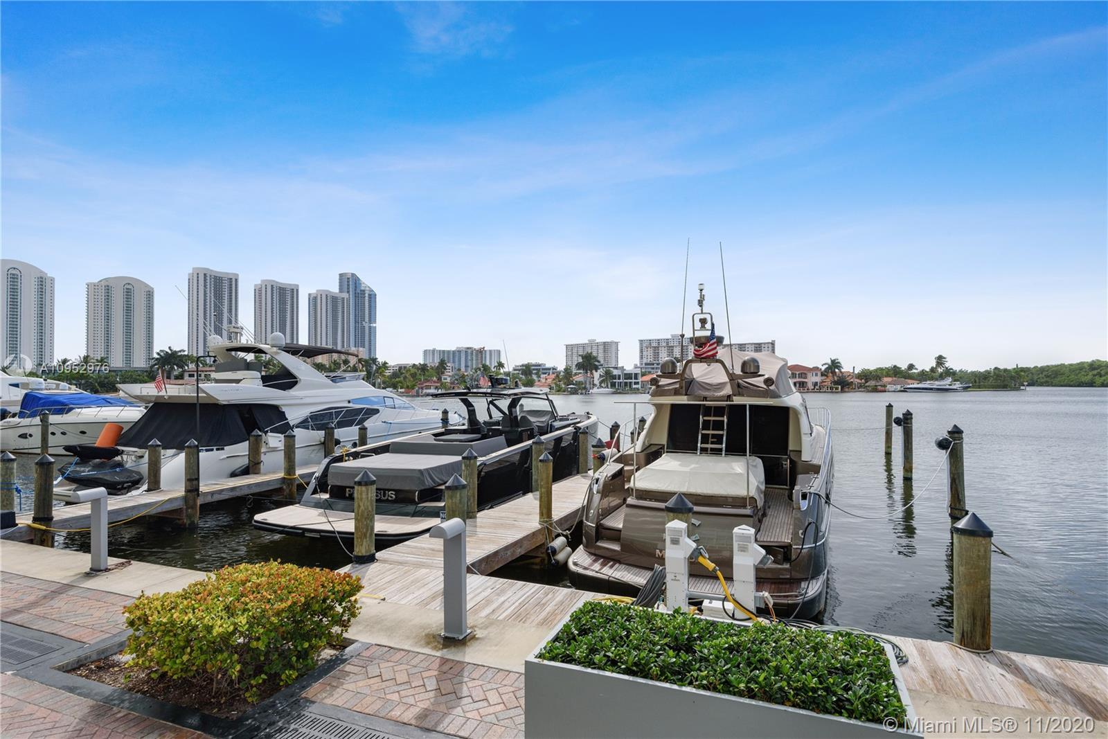 Boat lovers paradise! Enjoy beautiful views of both the marina and bay in this 2 story townhome with