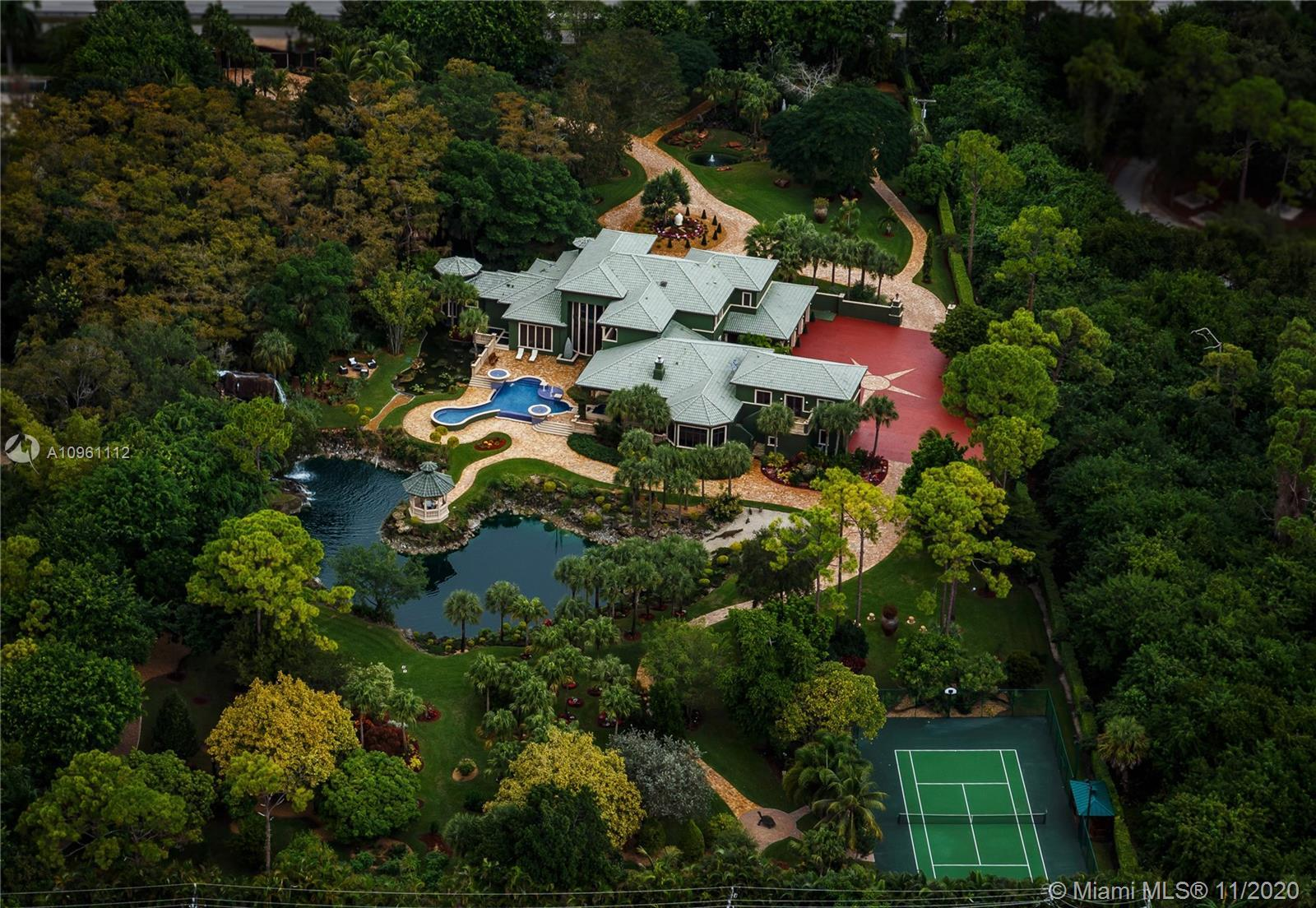 Presenting VILLA FLORENTYNA, a unique, 5 acres estate in the heart of south Florida. A private resid