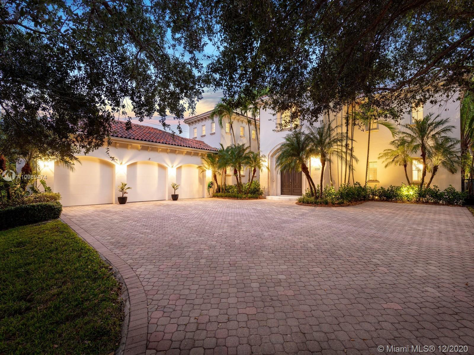 Impressive Two-Story Estate located in an exclusive gated and walled community in North Pinecrest wi