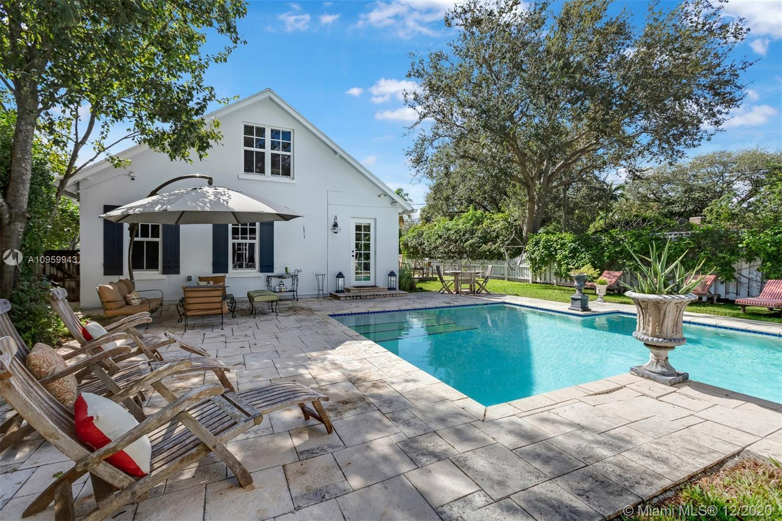 Charming doesn't even begin to describe this 1930 cottage-style home surrounded by white picket fenc