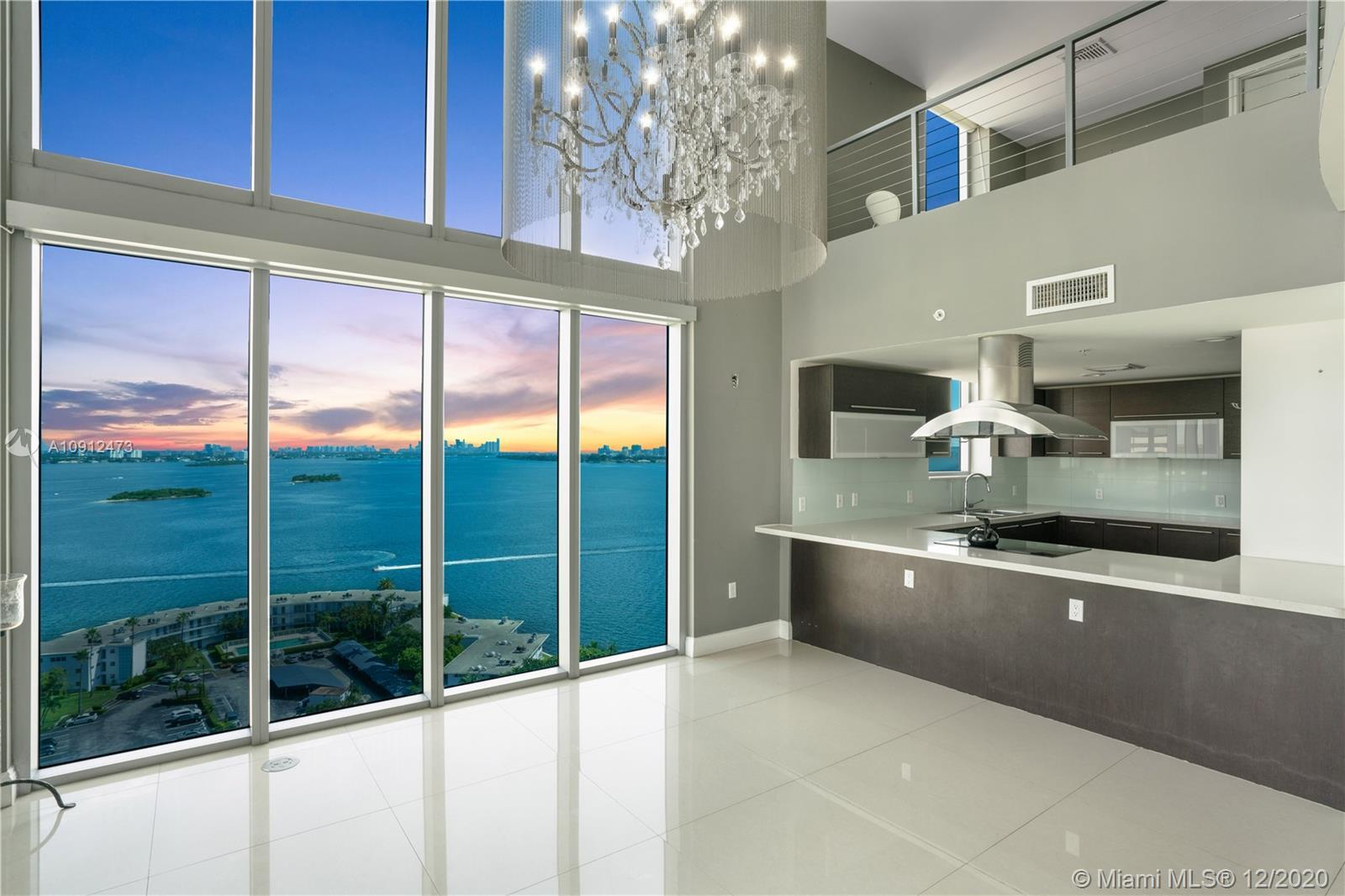 Lowest priced 2-story penthouse at Eloquence On The Bay! An unprecedented opportunity awaits for tho