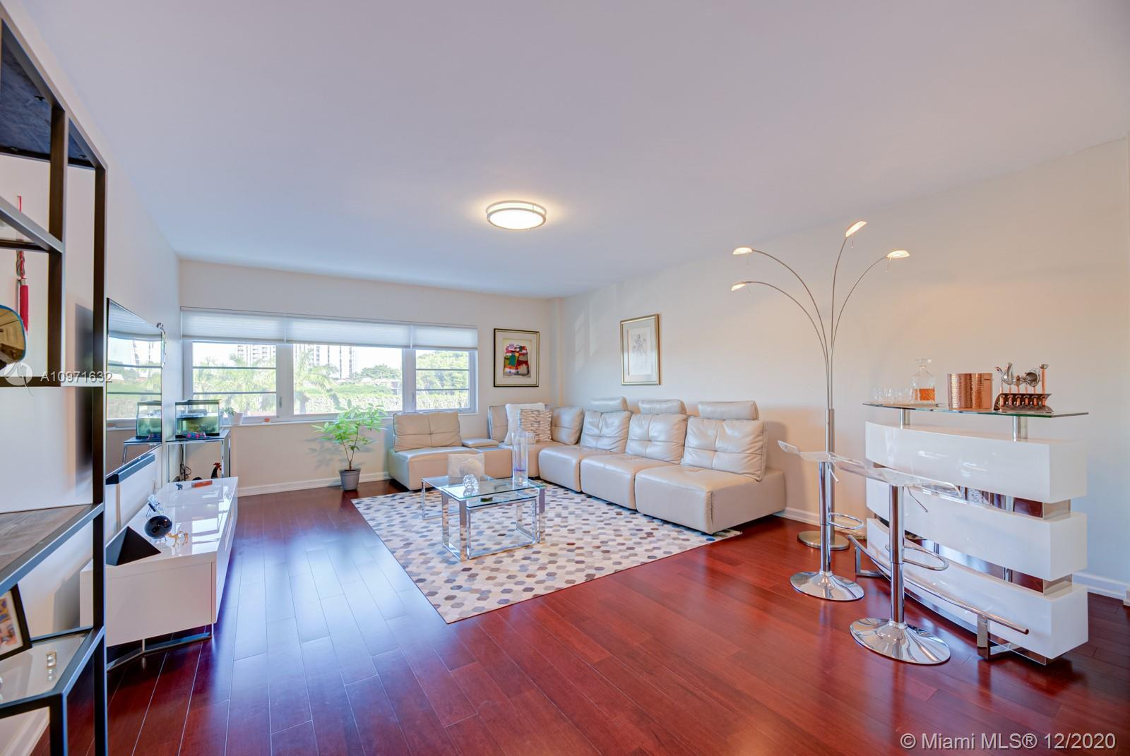 Spectacular 2 bed / 2 bath corner unit located in a boutique bay front building in peaceful and very