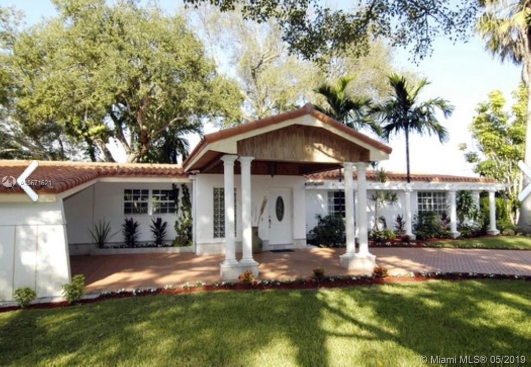 In the Heart of Pinecrest, this perfect family home is on a lovely U shaped street and provides any