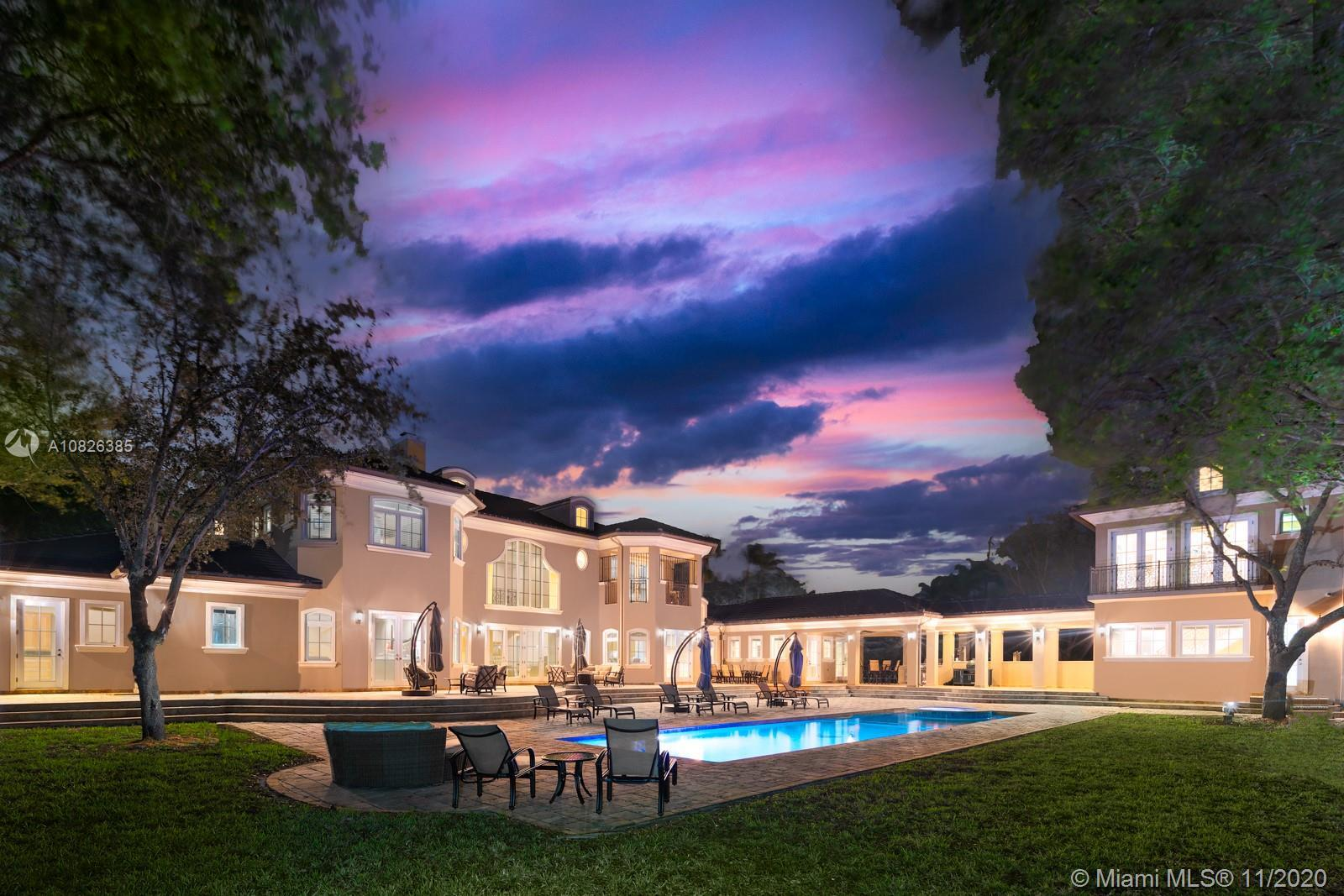 Spectacular 1-acre estate in coveted North Pinecrest featuring 8BR/8.5BA and 9,997 Adj. Sq. Ft. (11,