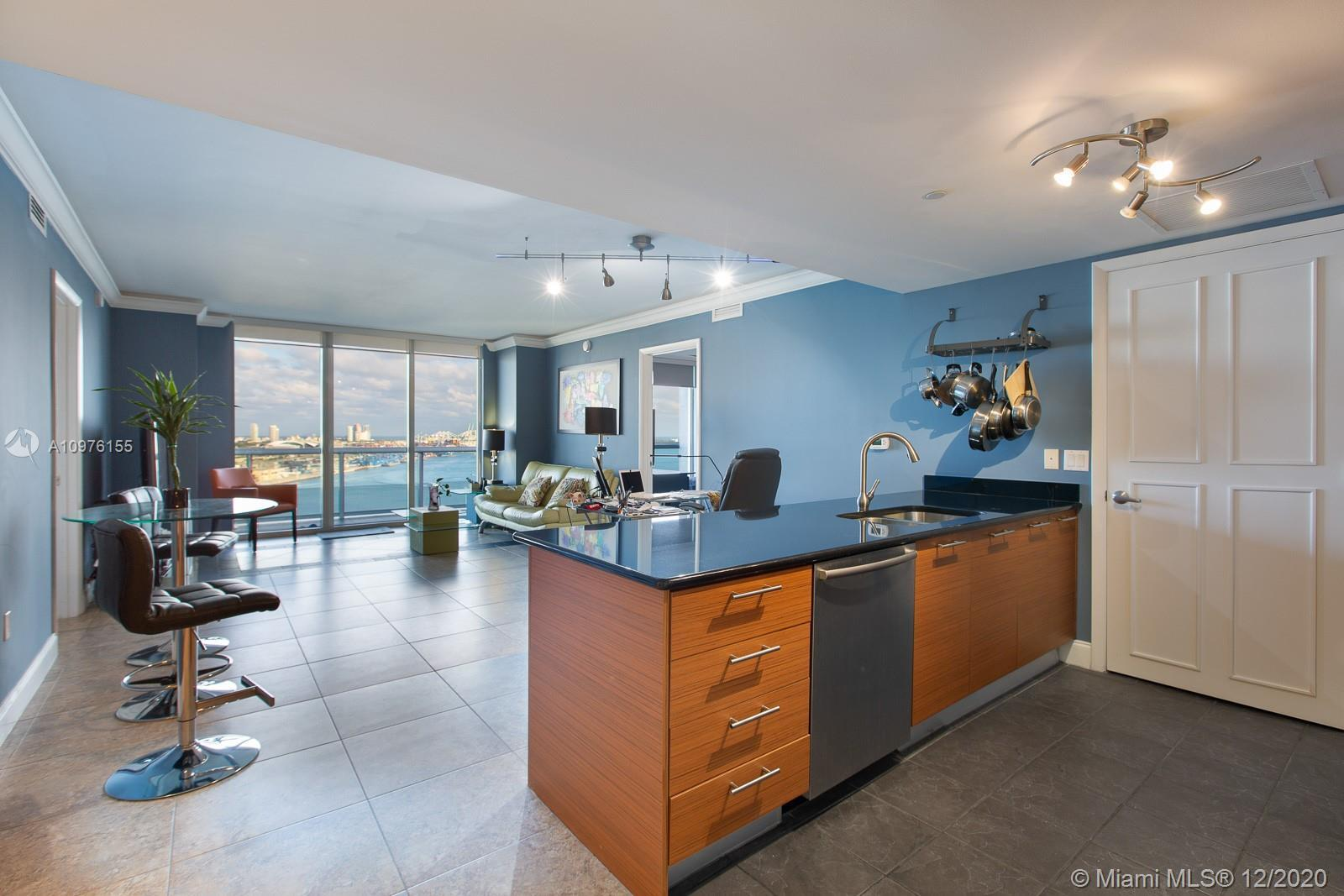 Enjoy beautiful city and bay views from your balcony at 50 Biscayne. This large 2/2 bedroom has an o