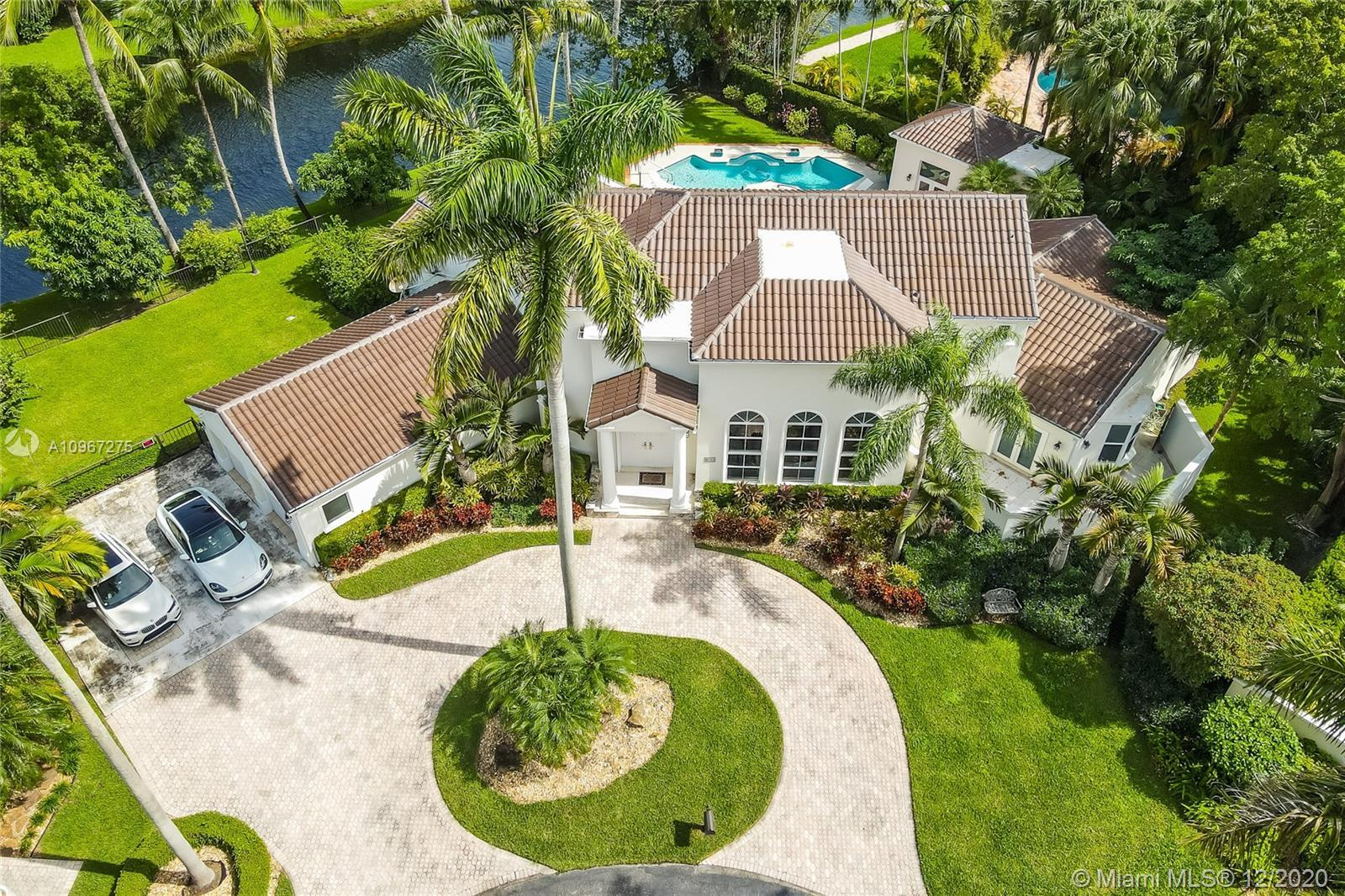 Fall in love with this north Pinecrest home located in a private gated community of only 11 properti