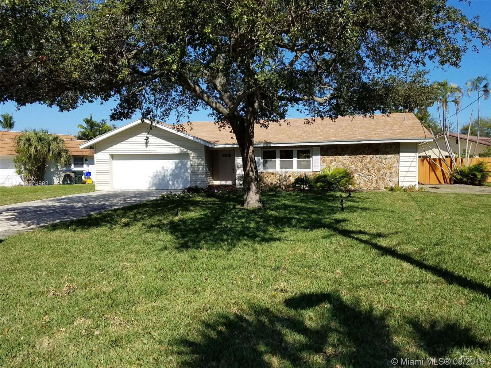 Beautiful landscaped corner lot with plenty of parking on the concrete driveway leading to your two