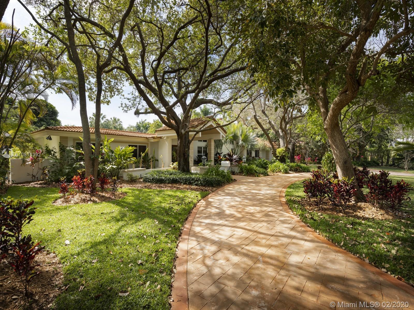 A classic family friendly home situated on the scenic backdrop of Pinecrest. Surrounded by a canopy