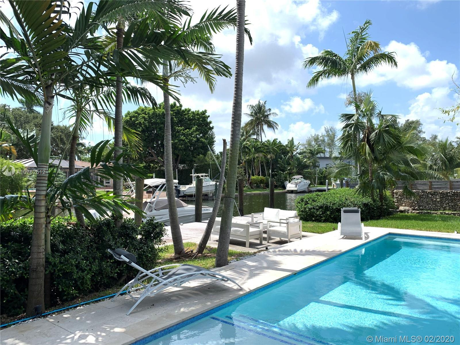 Beautifully renovated waterfront home, its spacious open interior is naturally lit.The modern house