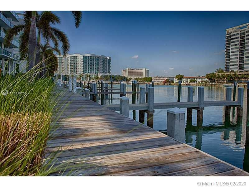 Spectacular unobstructed direct water views from this gorgeous, furnished 1 Bedroom + Den, 2 full ba