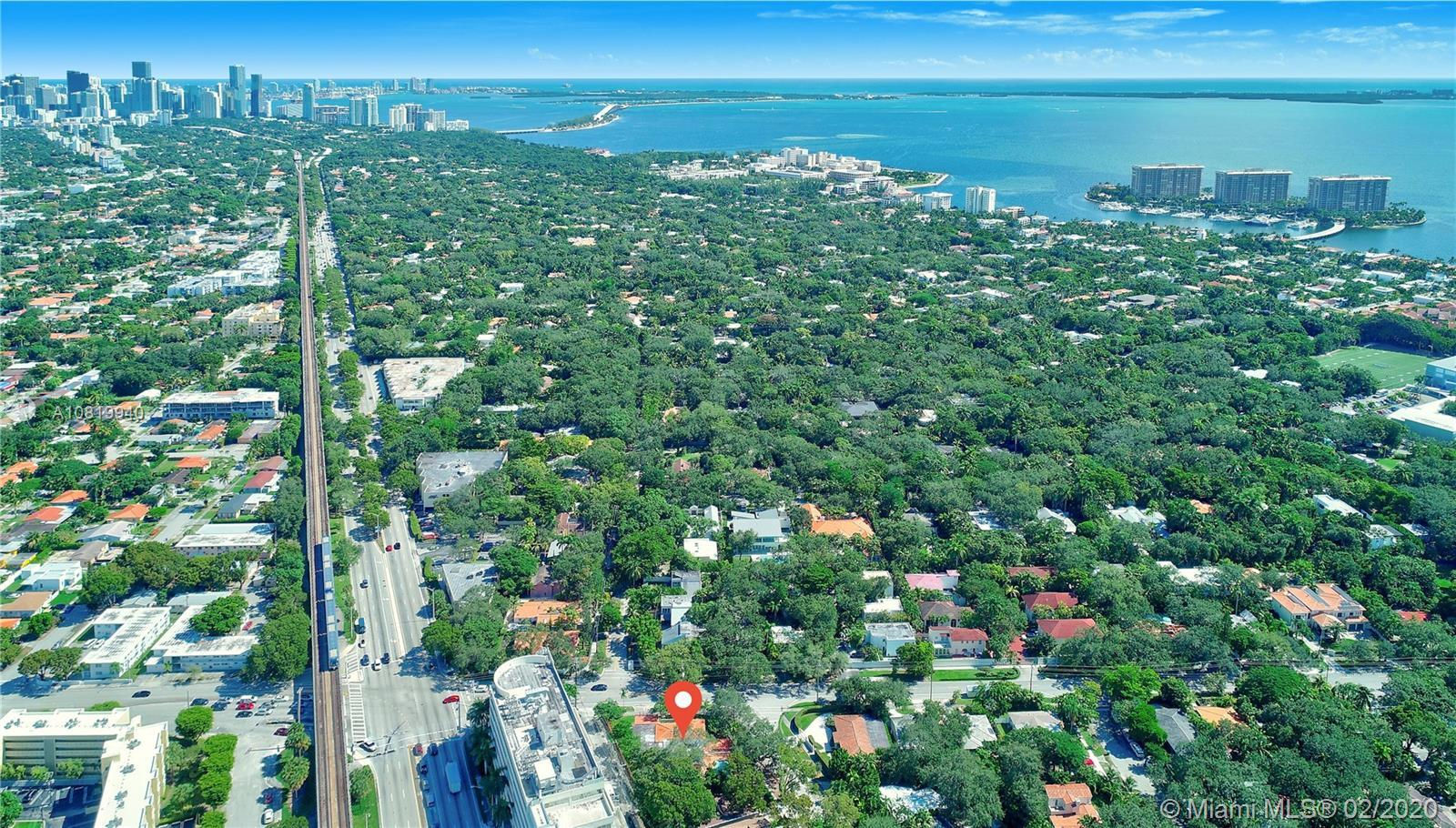 Large Single Family Home on a large Corner Lot, with 6 Bedrooms and 5 Bathrooms in the Coconut Grove