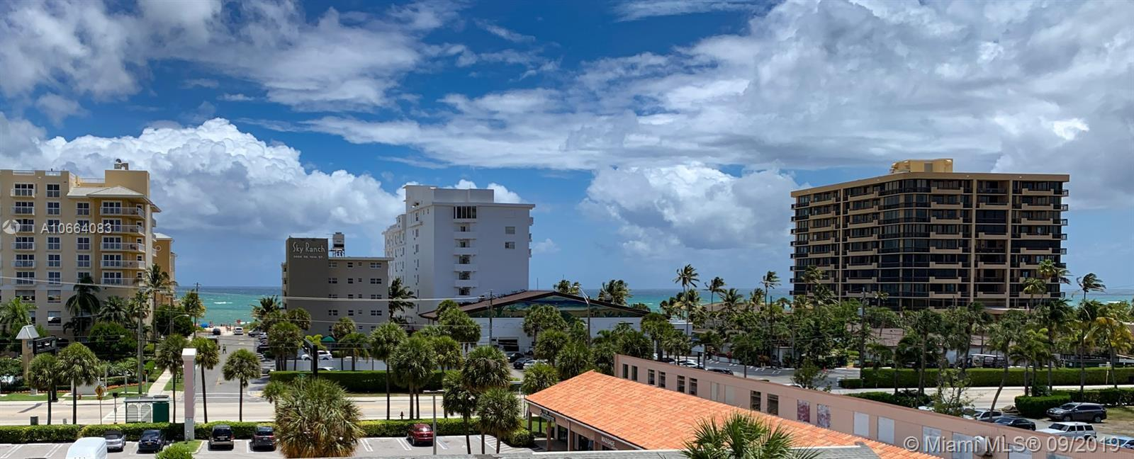 JUST REDUCED!! Magnificently renovated modern 2/2 unit across the street from the OCEAN! Corner unit