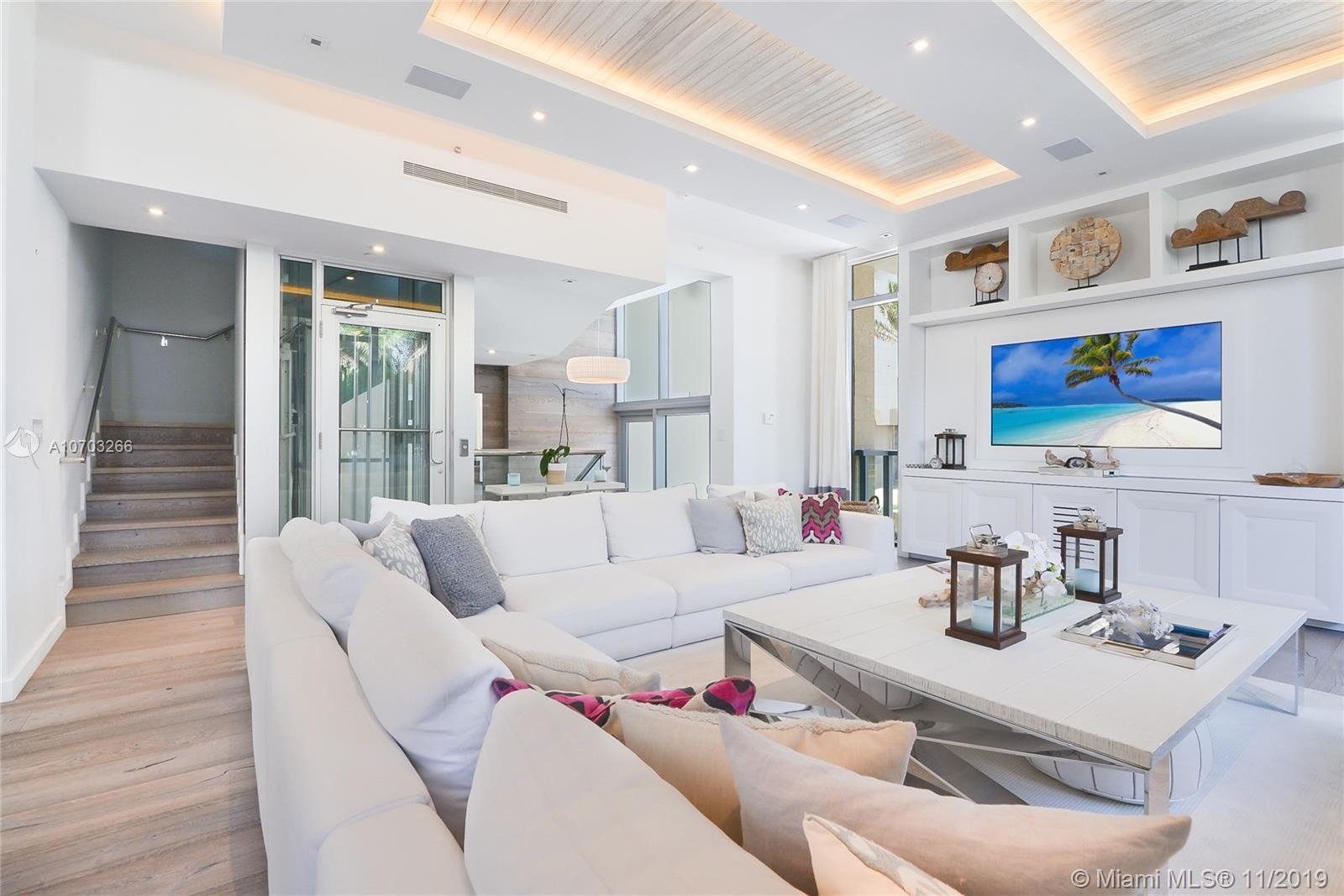 Truly rare to find, an exceptional beachfront townhome steps from the pristine BalHarbour shoreline.