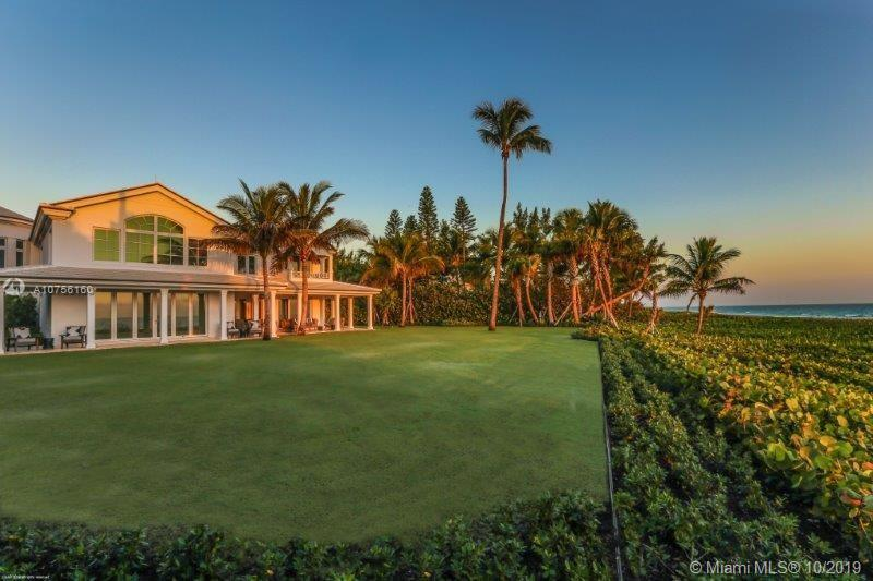 Be amazed at the impeccable workmanship of this exquisitely re-designed oceanfront home!  The 2-stor